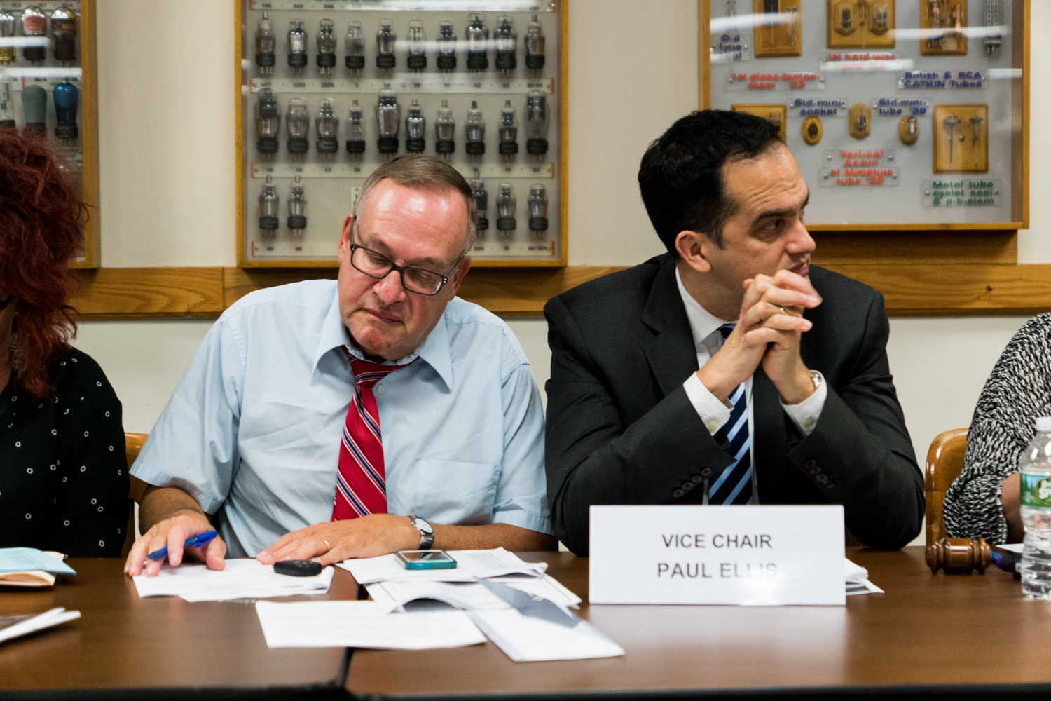 Michael Heller, left, the former district manager of Community Board 8, takes notes during a meeting last September. The search for a new district manager might be expanding, giving new potential candidates a chance to apply.