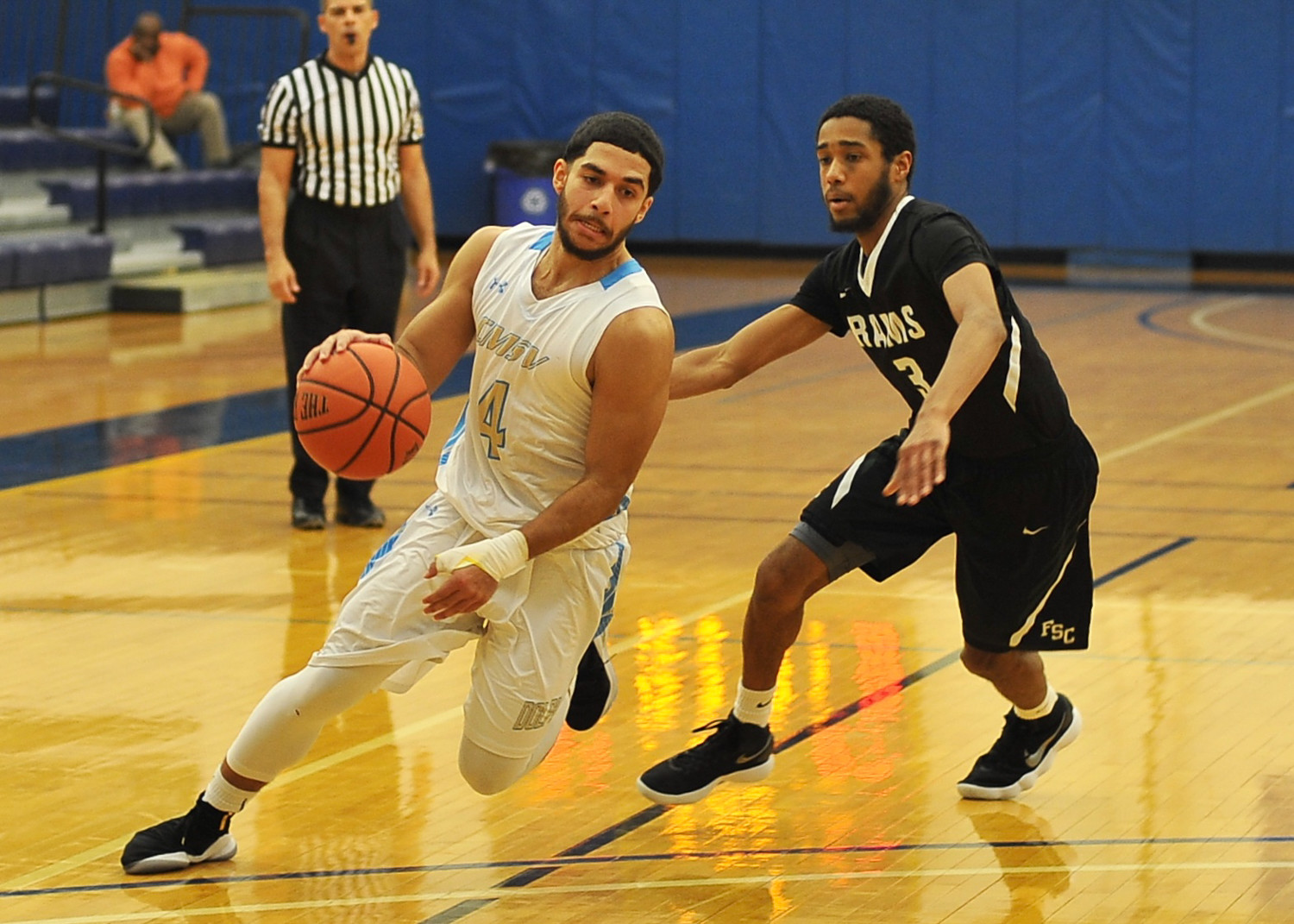 Mount Saint Vincent's Jose Maestre (4) looks to get by Farmingdale's Matthew Graham during the Dolphins' Skyline Conference victory last Friday night.