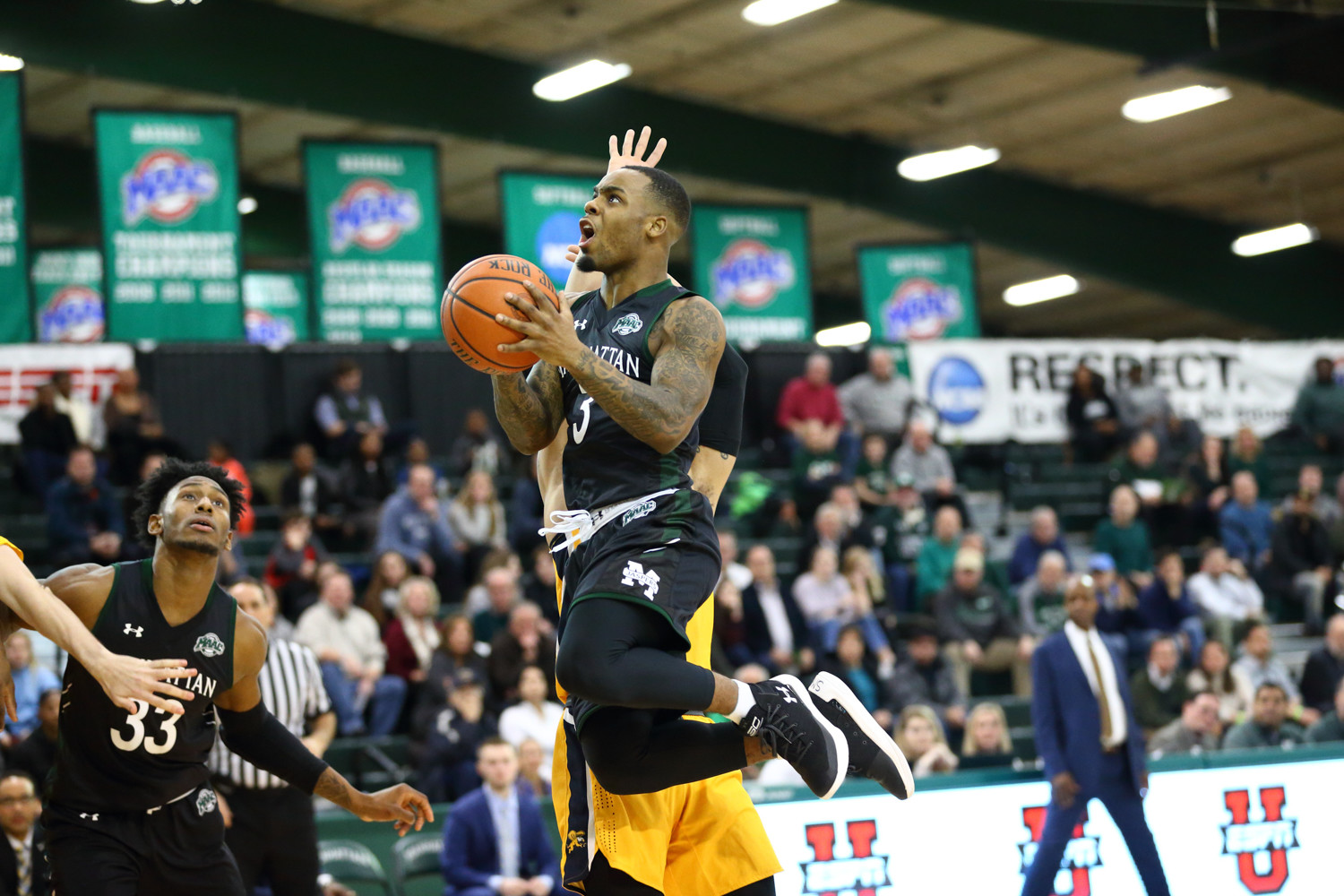 Jaspers' senior guard Zavier Turner (3), shown here against Canisius Friday night, logged a double-double with 20 points and 10 assists in Manhattan's victory over St. Peter's Sunday afternoon.