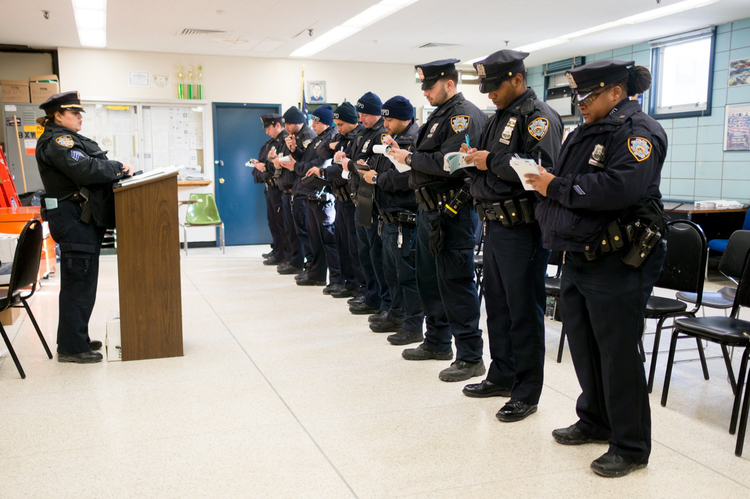Police officers receive their assignments at roll call in the 50th Precinct. Crime in the precinct is down slightly in 2017, with 974 reported crimes across seven major felony categories.