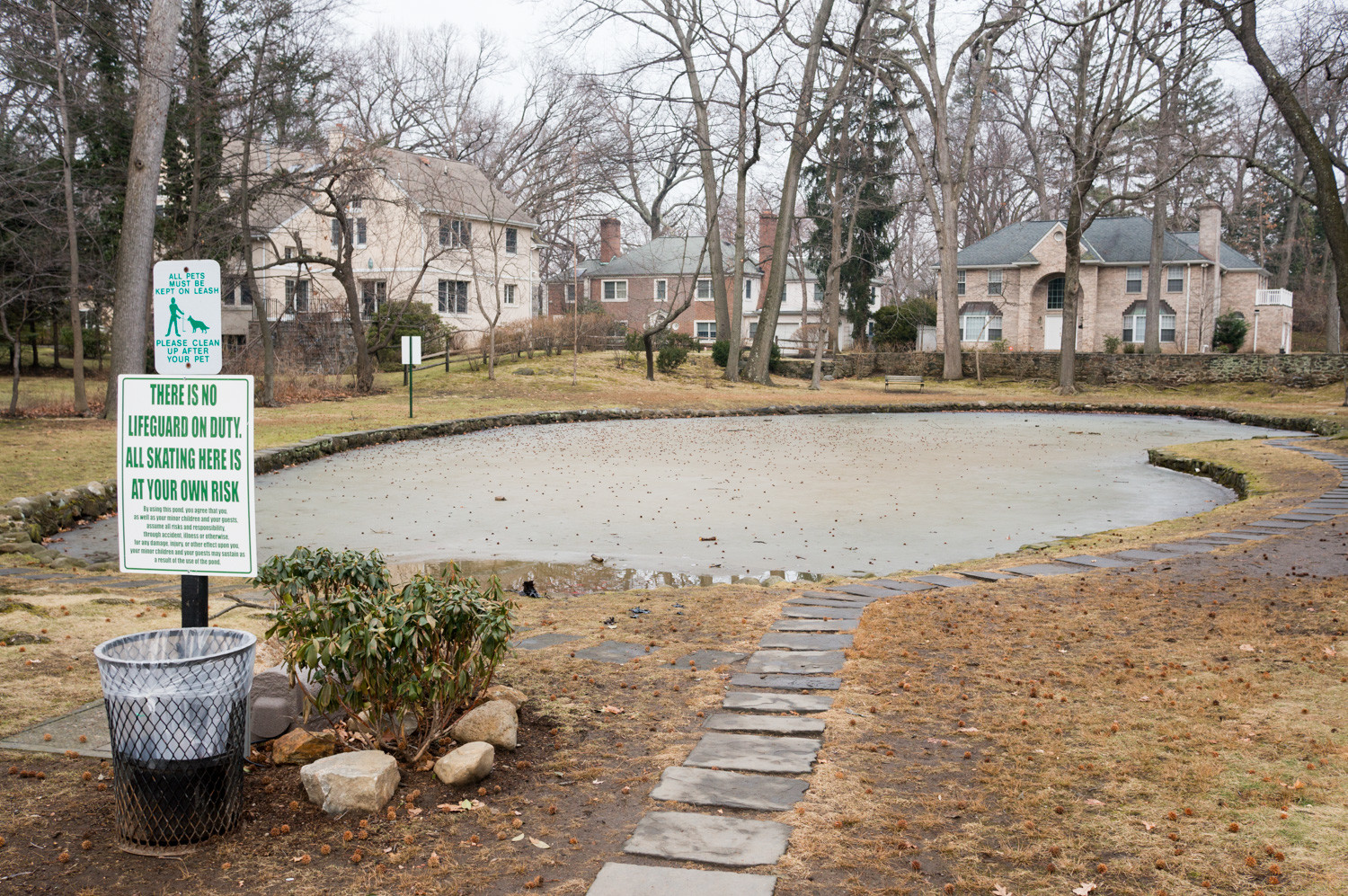 Indian Pond is frozen over in the dead of winter. A controversial plan to develop 1.3 acres of land overlooking the pond looks like it might be dead, as the property is up for sale.