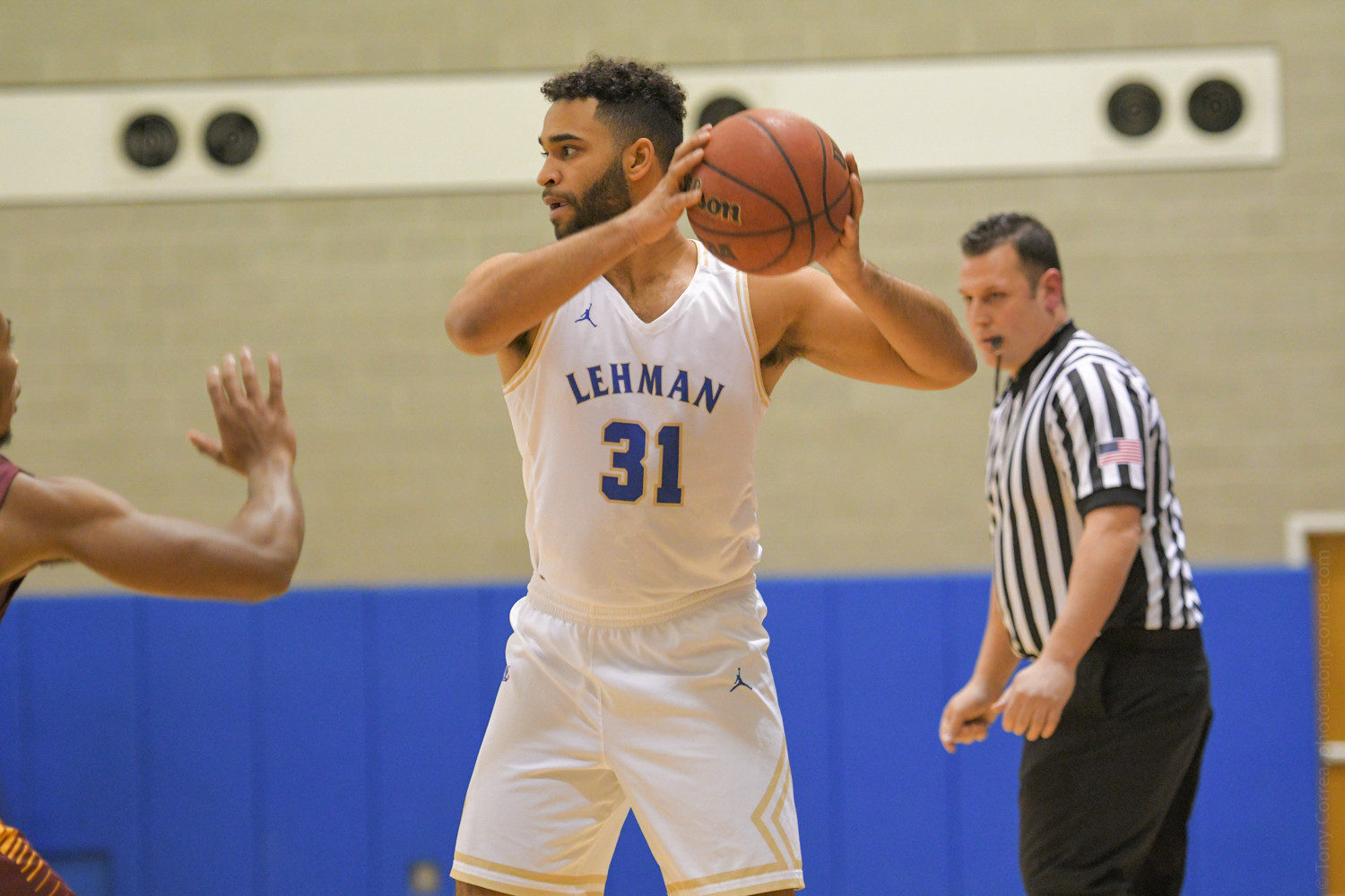 Lehman senior Andrew Utate goes to work against York in the Lightning's 88-63 win last week.