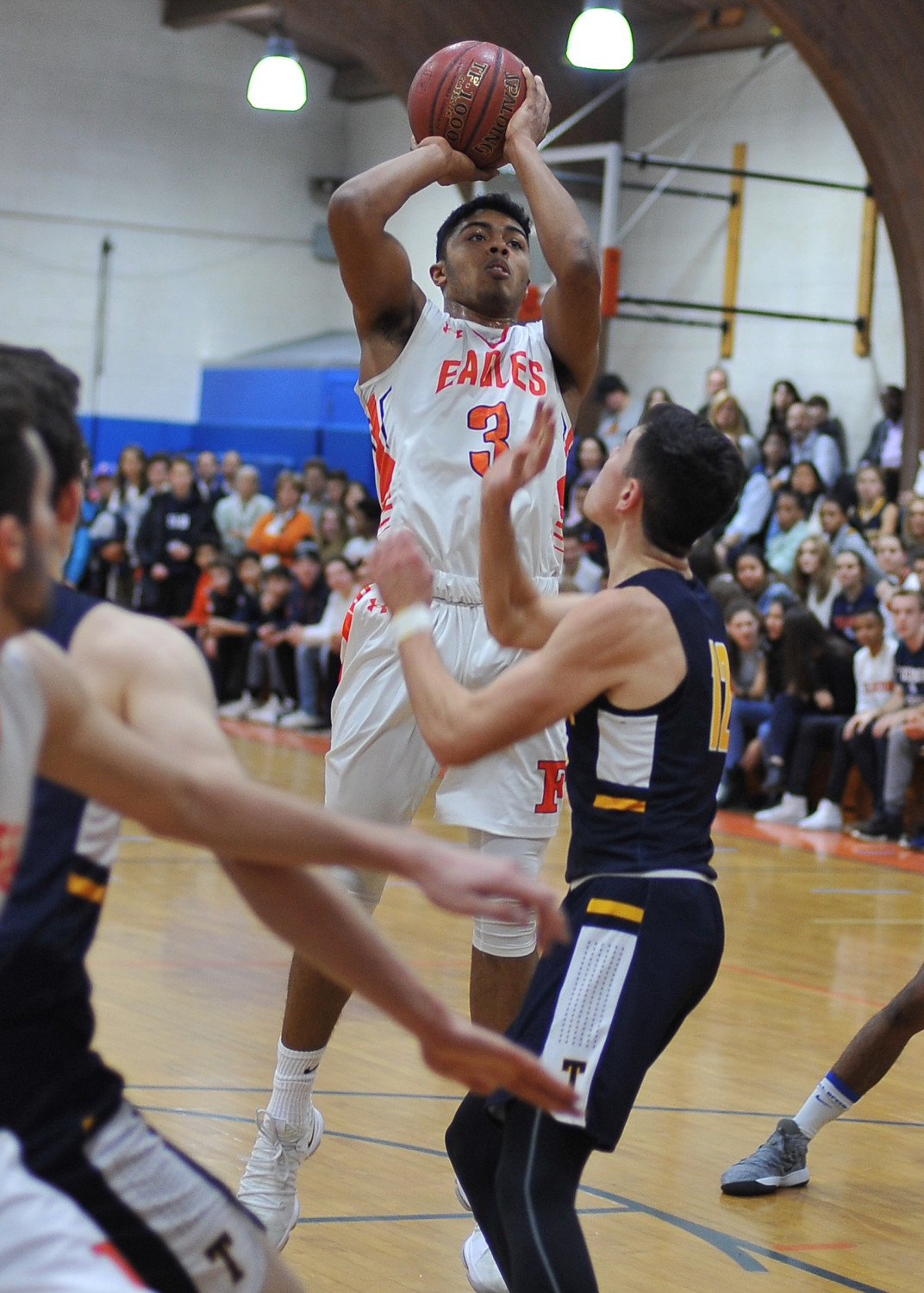 Fieldston's Jared Maharaj pulls up for a shot during his 25-point game last Friday in the Eagles' Ivy League victory over Trinity.
