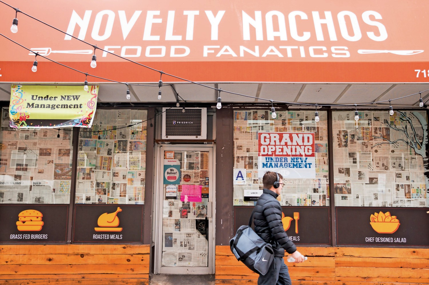 A pedestrian passes by what was once Novelty Nachos. The restaurant will reopen with a new name under new management.