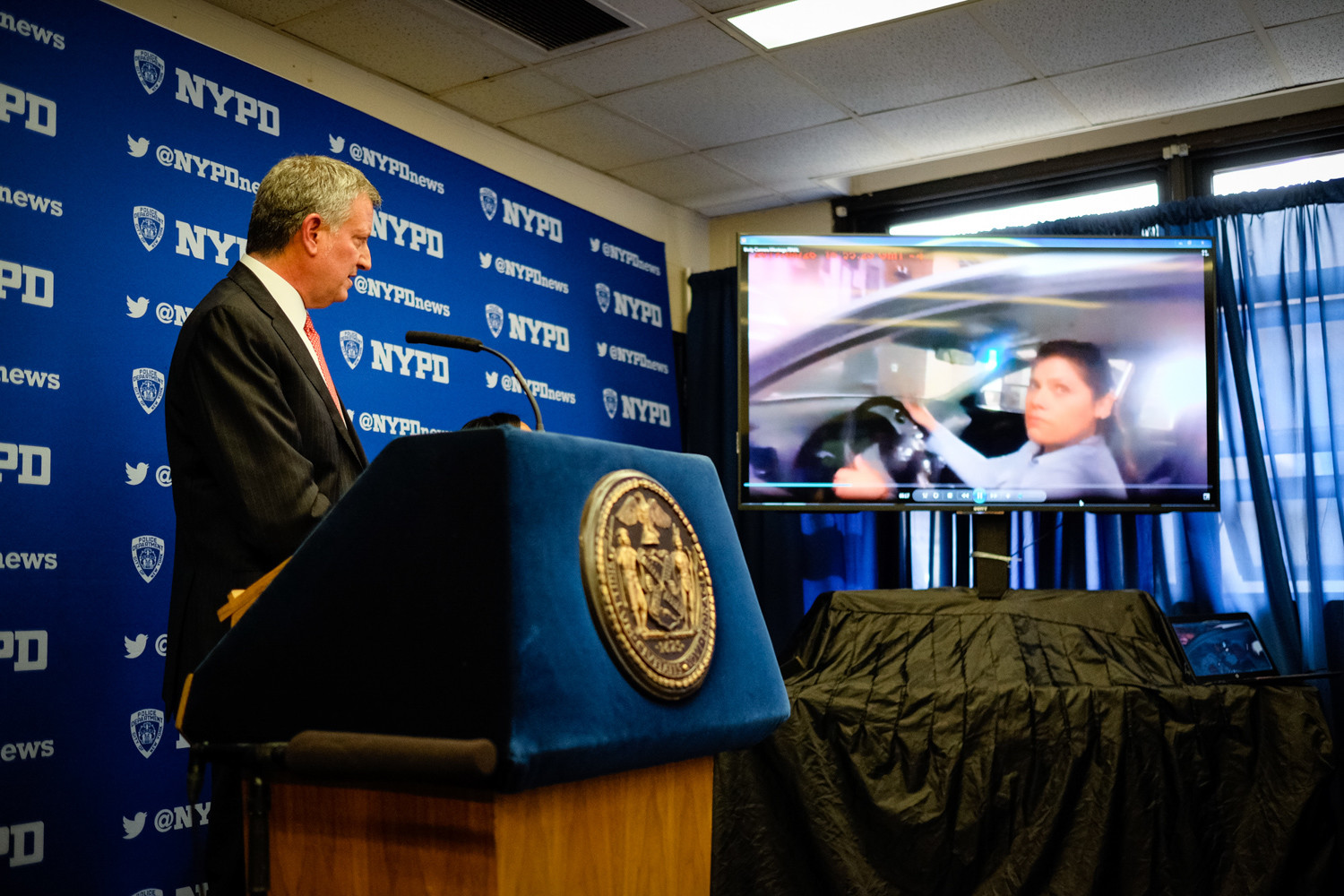 Mayor Bill de Blasio, shown describing an image captured by a police body camera, announced an accelerated plan to equip all patrol officers with them.