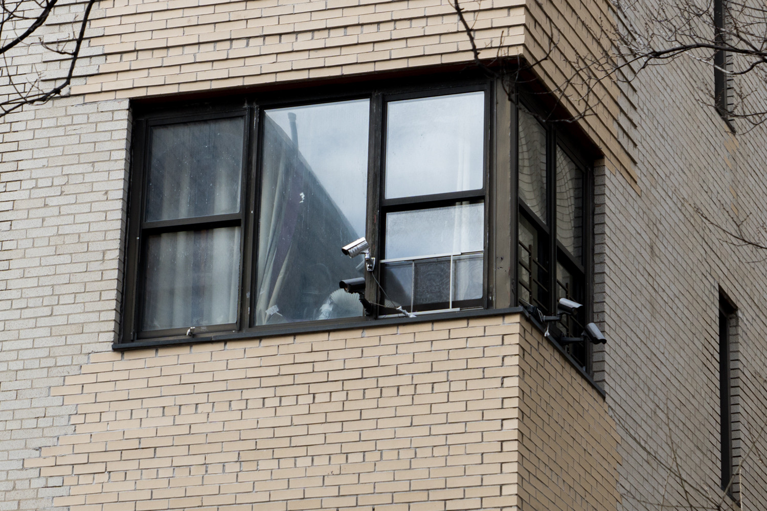 Four security cameras are mounted outside of 3045 Godwin Terrace. Tenants there have joined renters in two other Bronx apartment buildings in separate class-action lawsuits claiming their landlords are violating the J-51 tax abatement program.