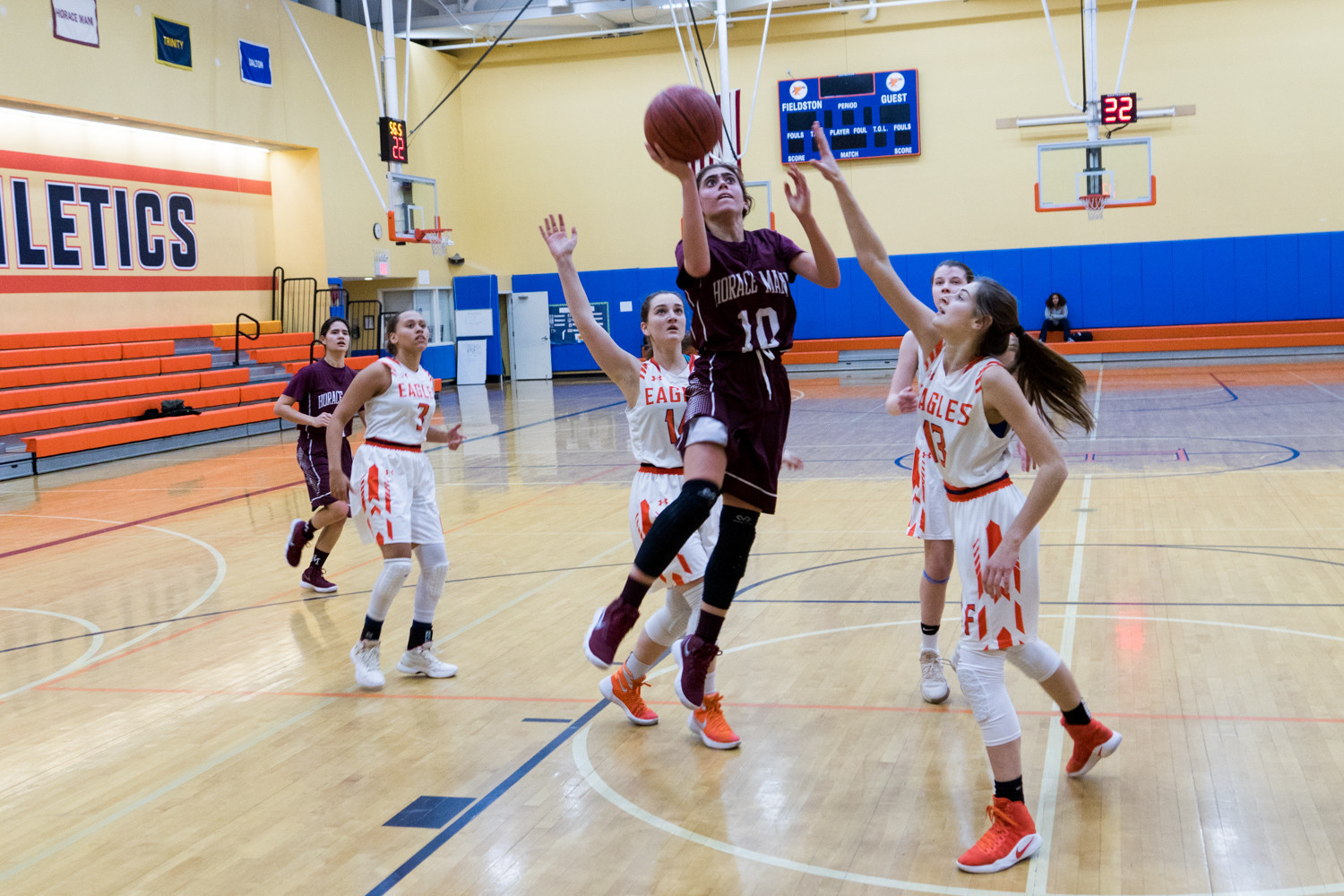 Horace Mann sophomore point guard Halley Robbins splits the lane for a basket in the Lions' Ivy League victory over Fieldston.