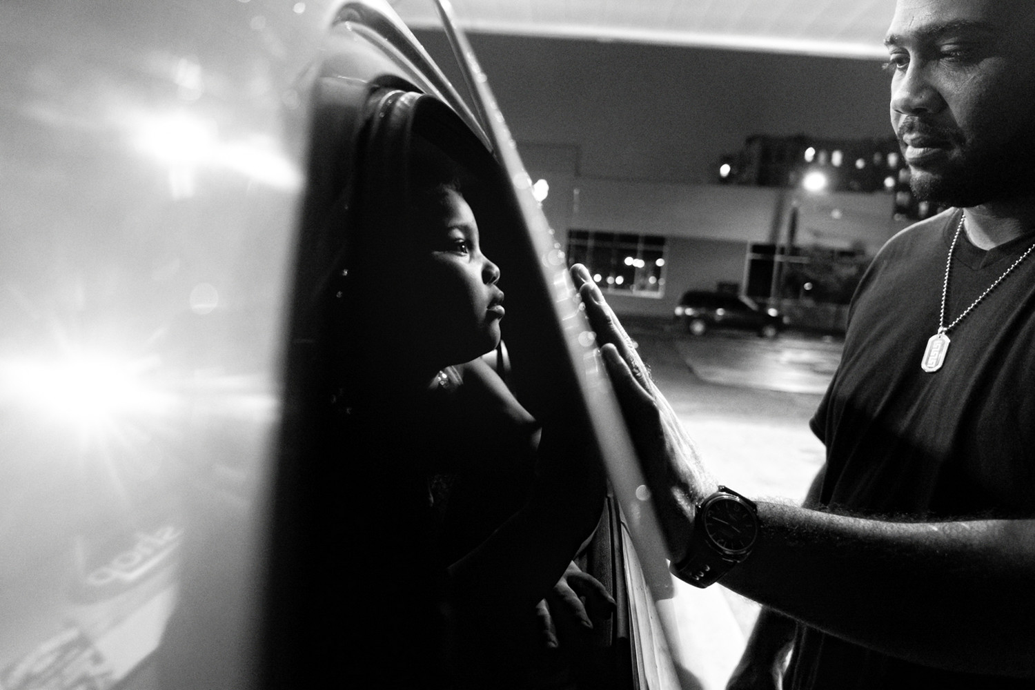 Billy Garcia and his daughter Esmeralda enjoy a tender moment at a gas station in the Bronx in 2012. Zun Lee's exhibition 'Father Figure: Exploring Alternate Notions of Black Fatherhood' is on display at the Bronx Documentary Center until March 31.
