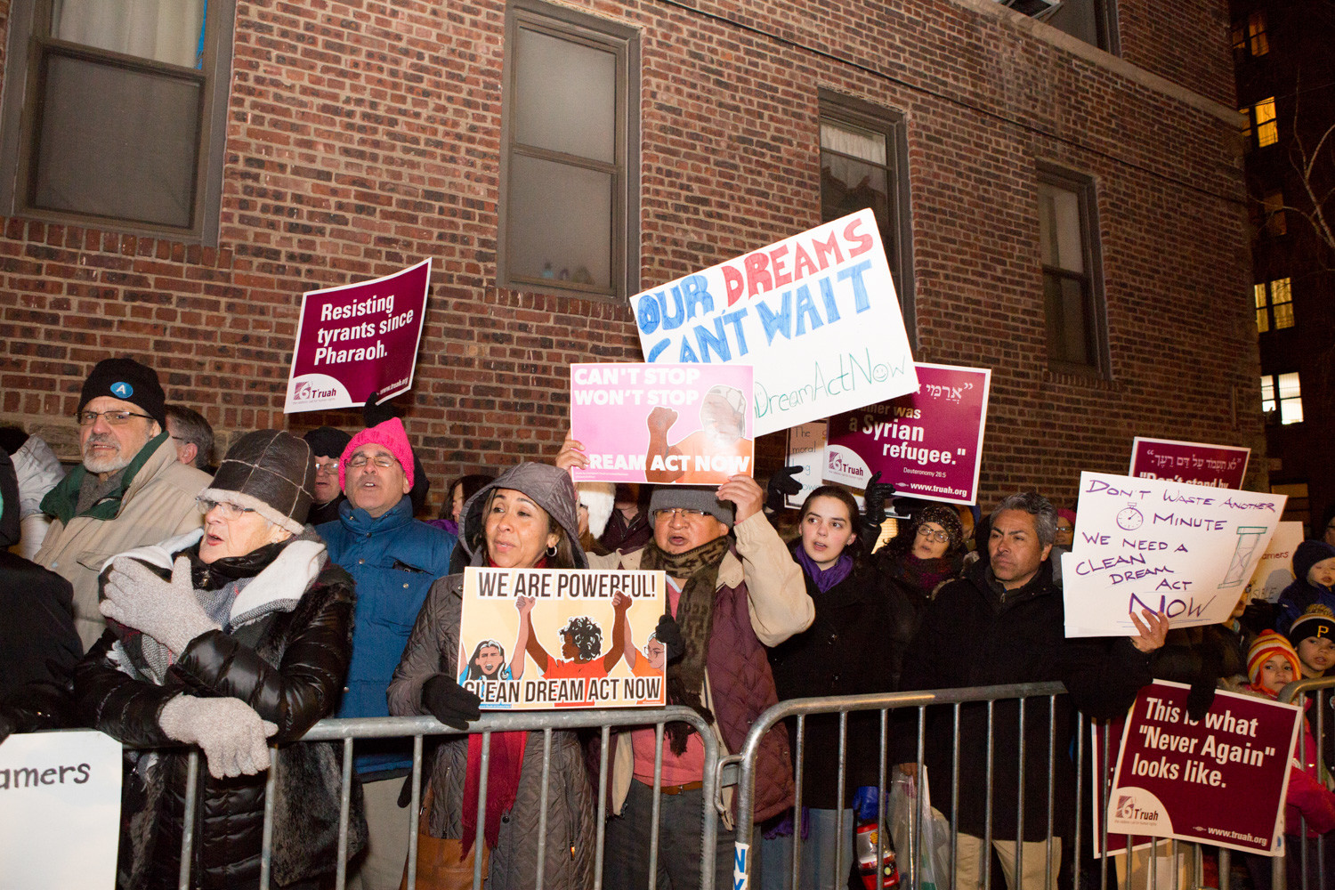 People hold signs and chant at a rally urging Congress to pass a clean DREAM Act outside of U.S. Rep. Eliot Engel's Bronx office last Thursday.