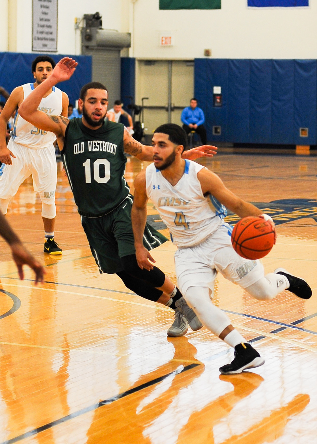 College of Mount Saint Vincent senior guard Jose Maestre works his way around Old Westbury's Preston Powell, but the Dolphins couldn't come up with a win on Senior Day.