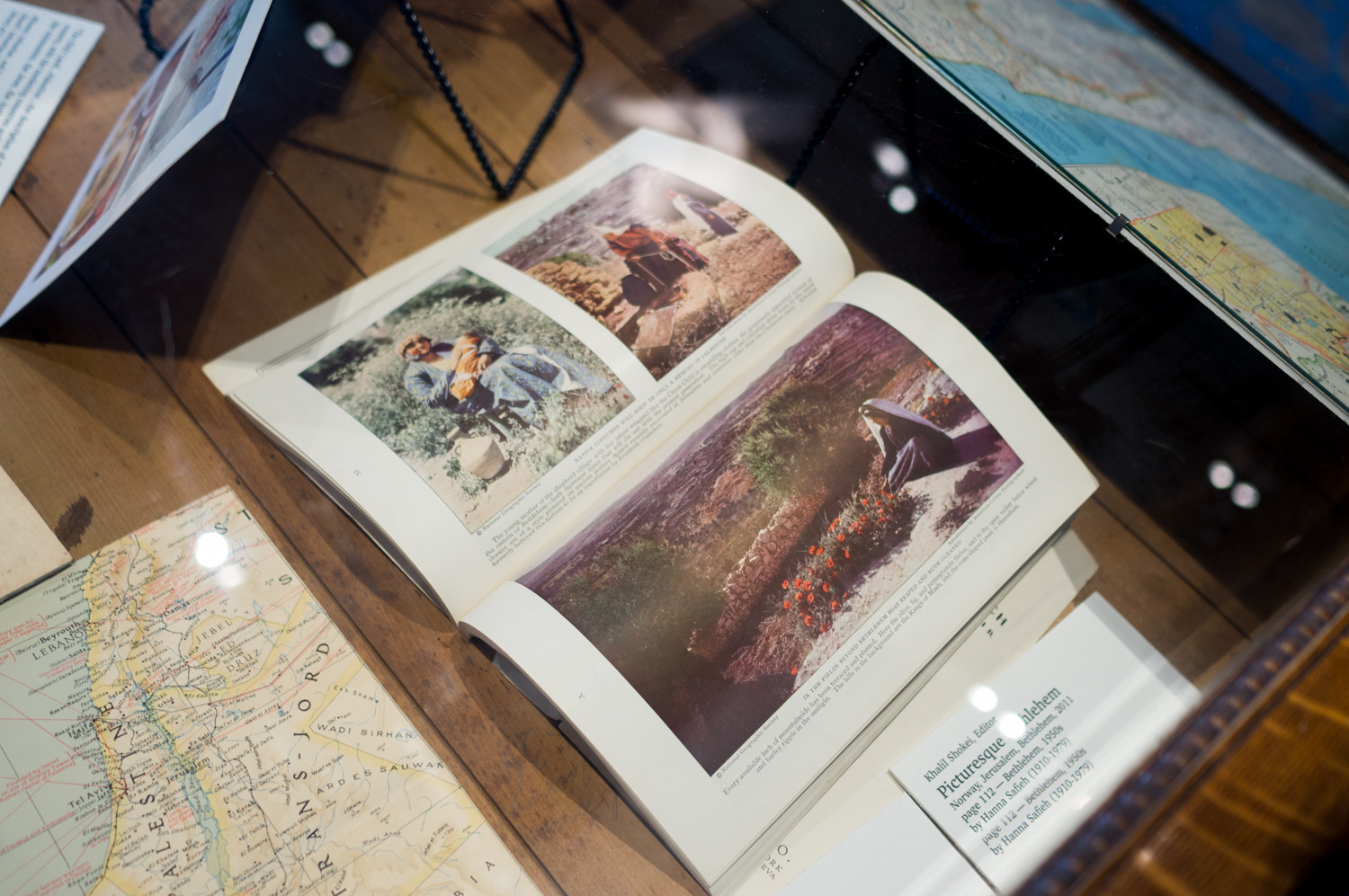 A 1929 issue of National Geographic features color photographs of Bethlehem in Palestine. It is part of a traveling exhibition called 'Bethlehem Beyond the Wall' at Manhattan College.