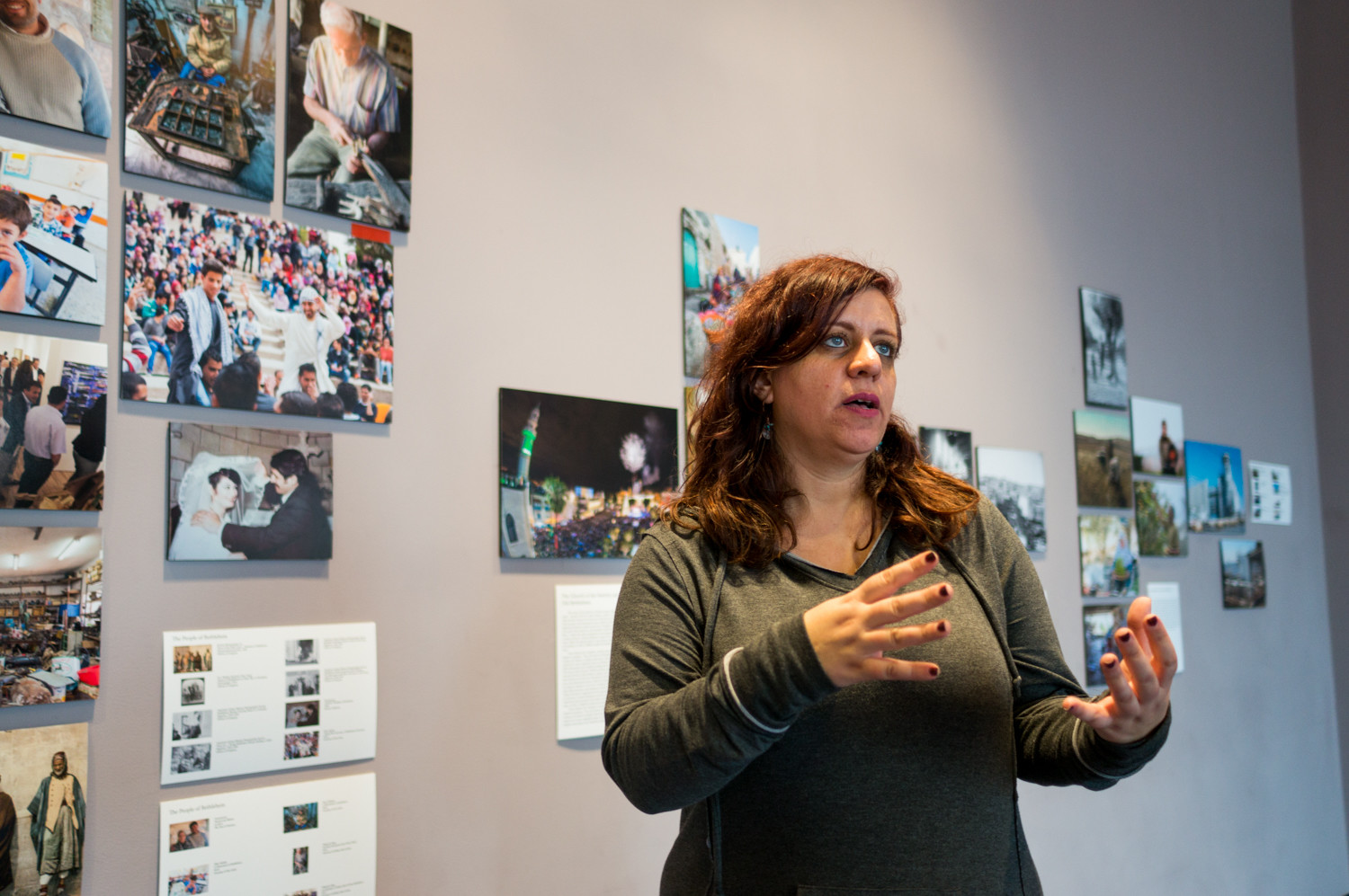 Nada Odeh talks about the different works on display in the traveling exhibition 'Bethlehem Beyond the Wall' at Manhattan College. Odeh is involved with the Museum of the Palestinian People, and helped put up the exhibition at Manhattan College.