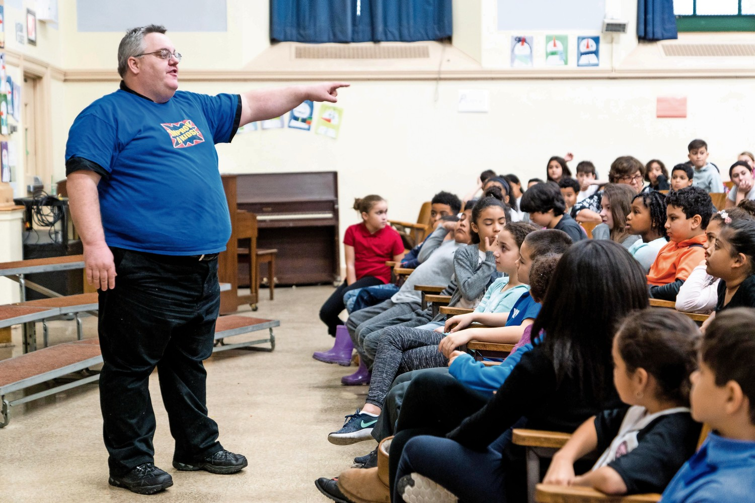 Will Frasier, a founding member of the improv troupe 'Eight is Never Enough,' explains the fundamentals of improvisational comedy to students at P.S. 24.