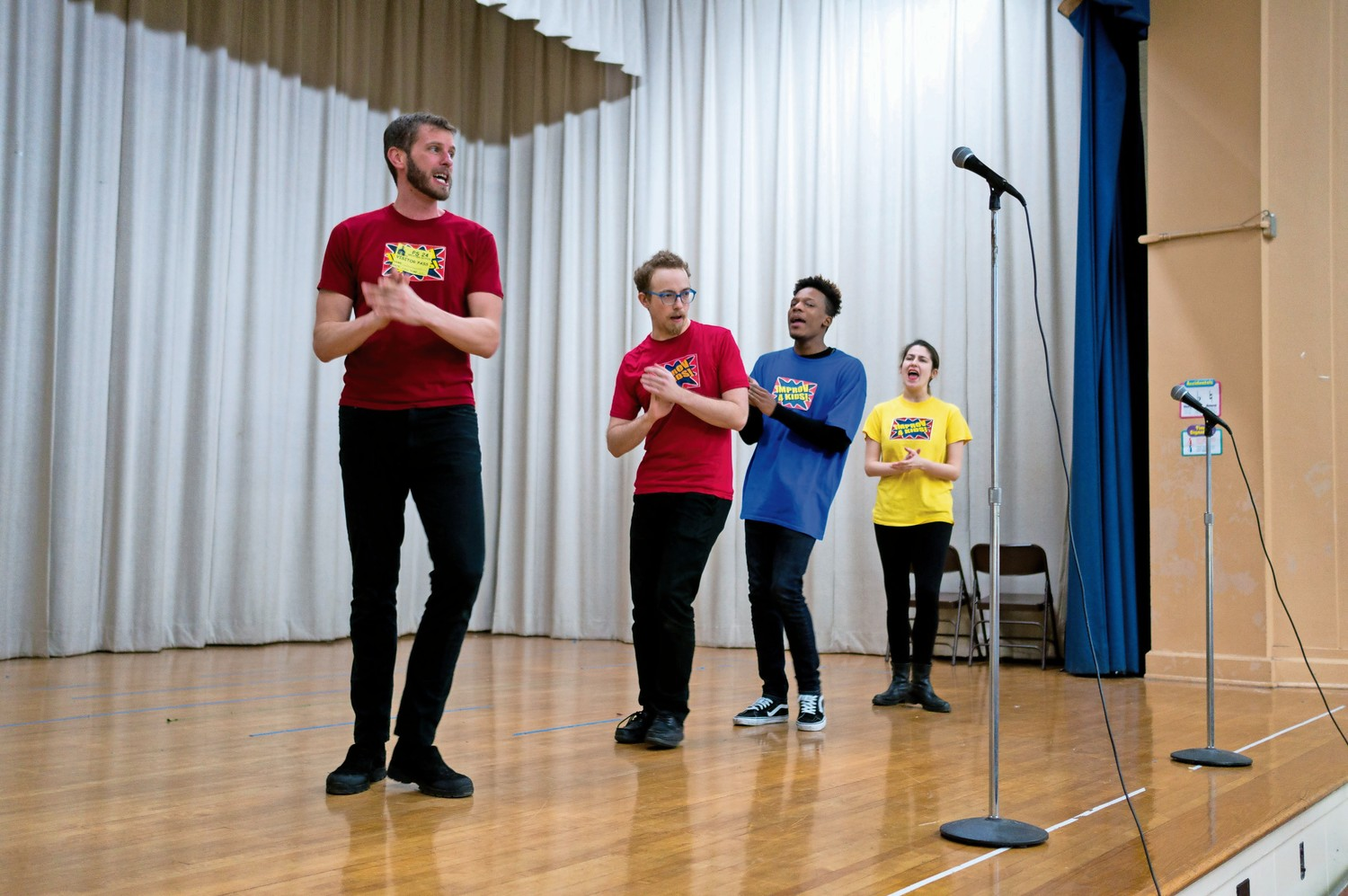 Members of the improv comedy troupe 'Eight is Never Enough' improvise a song title 'The Hot Pocket Blues' at P.S. 24.