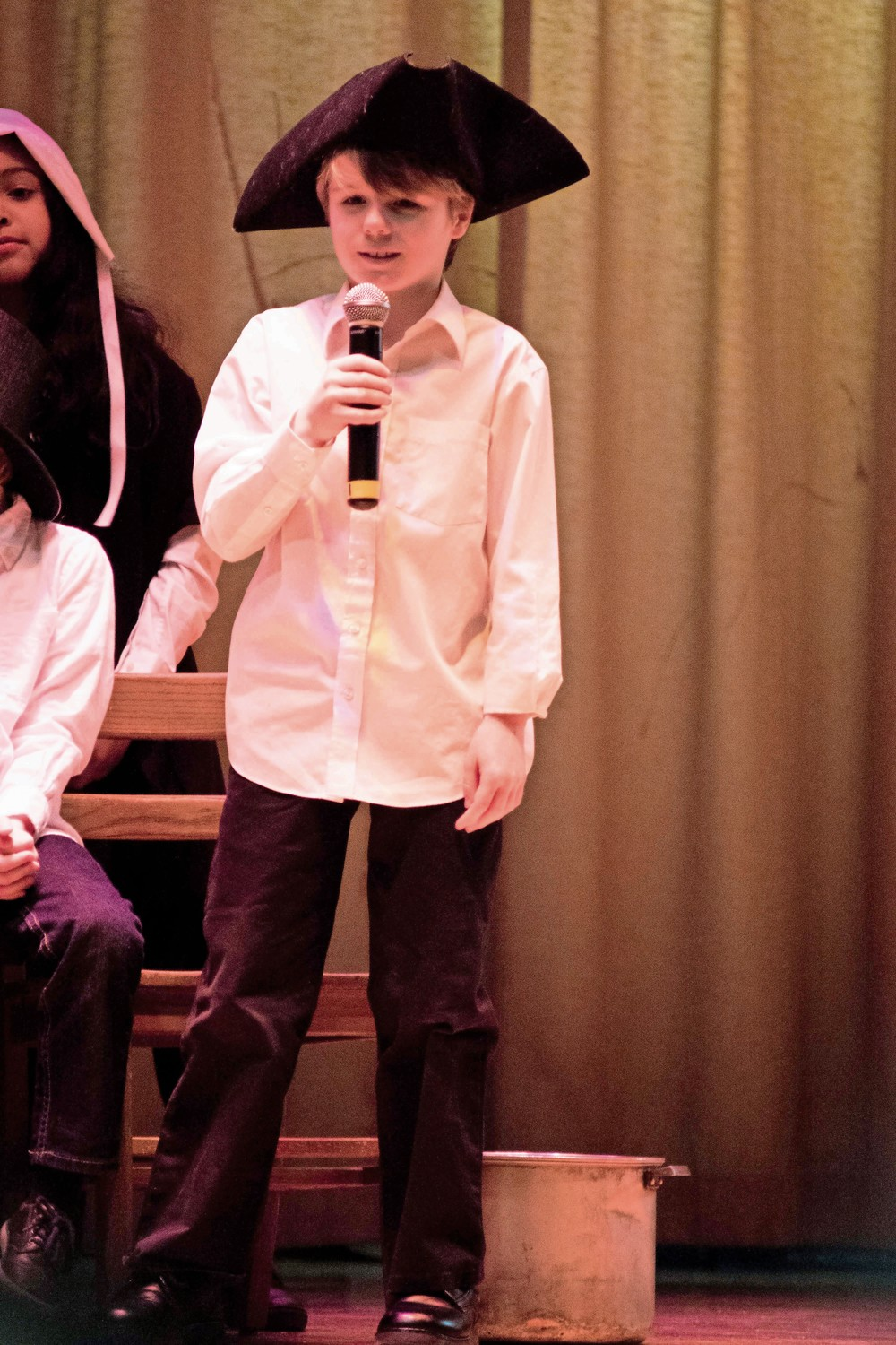 Cian Gaughan, a fourth-grade student, at P.S. 81 speaks in a play about early American history. The school has adopted a new social studies curriculum called 'Passport to Social Studies,' which encourages students to think like historians.