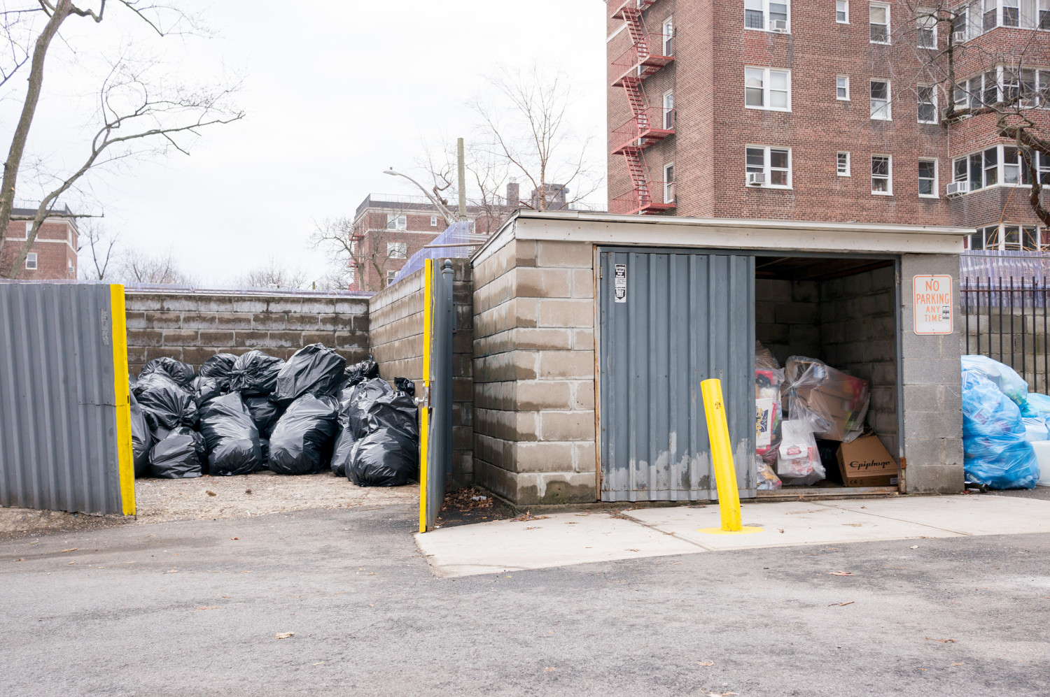 A row of dumpsters and a bleak cinder block wall on Netherland Avenue between West 254th and West 256th streets block pedestrian access. Community Board 8's traffic and transportation committee has opposed talk of possibly building a walkway on Netherland connecting West 256th and West 254th streets.