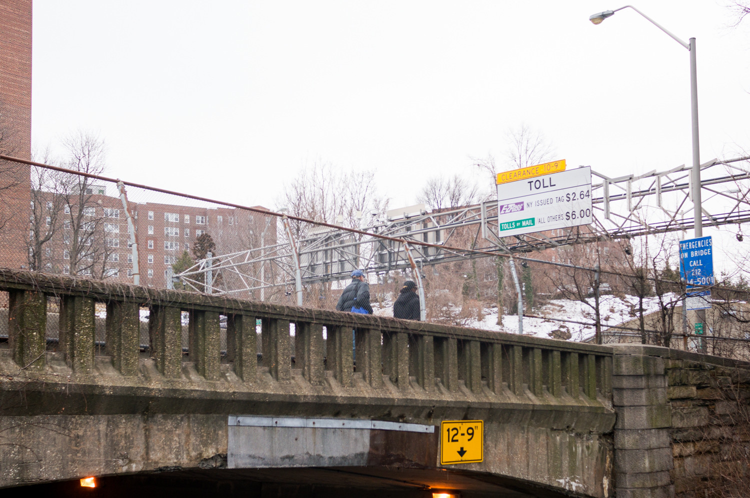 Pedestrians walk along the Henry Hudson Bridge's pedestrian pathway. Ongoing construction on the bridge will eventually shut down the pathway for months.