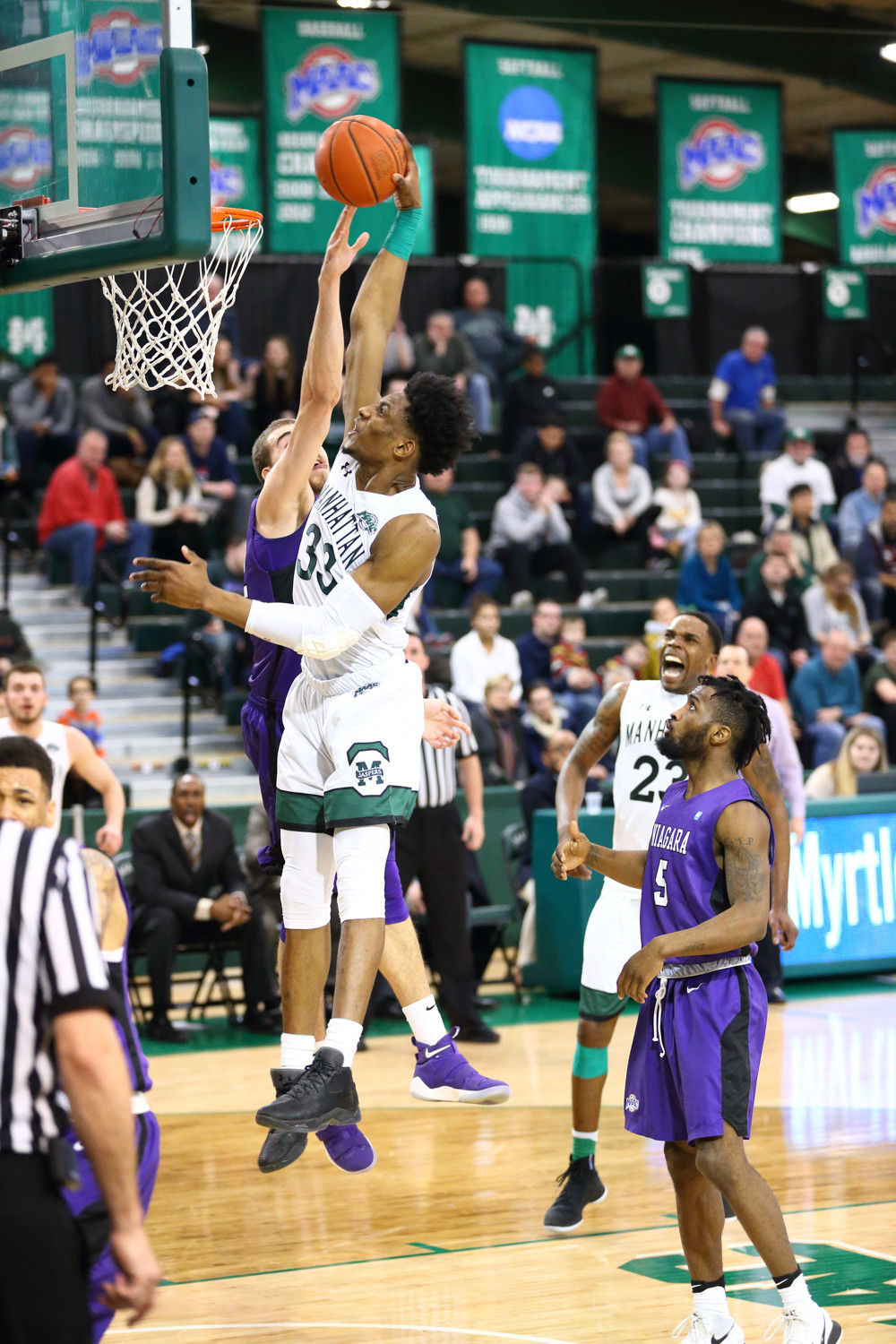 Pauly Paulicap prepares to slam home two of his 13 points in Manhattan's 82-72 victory over Niagara.