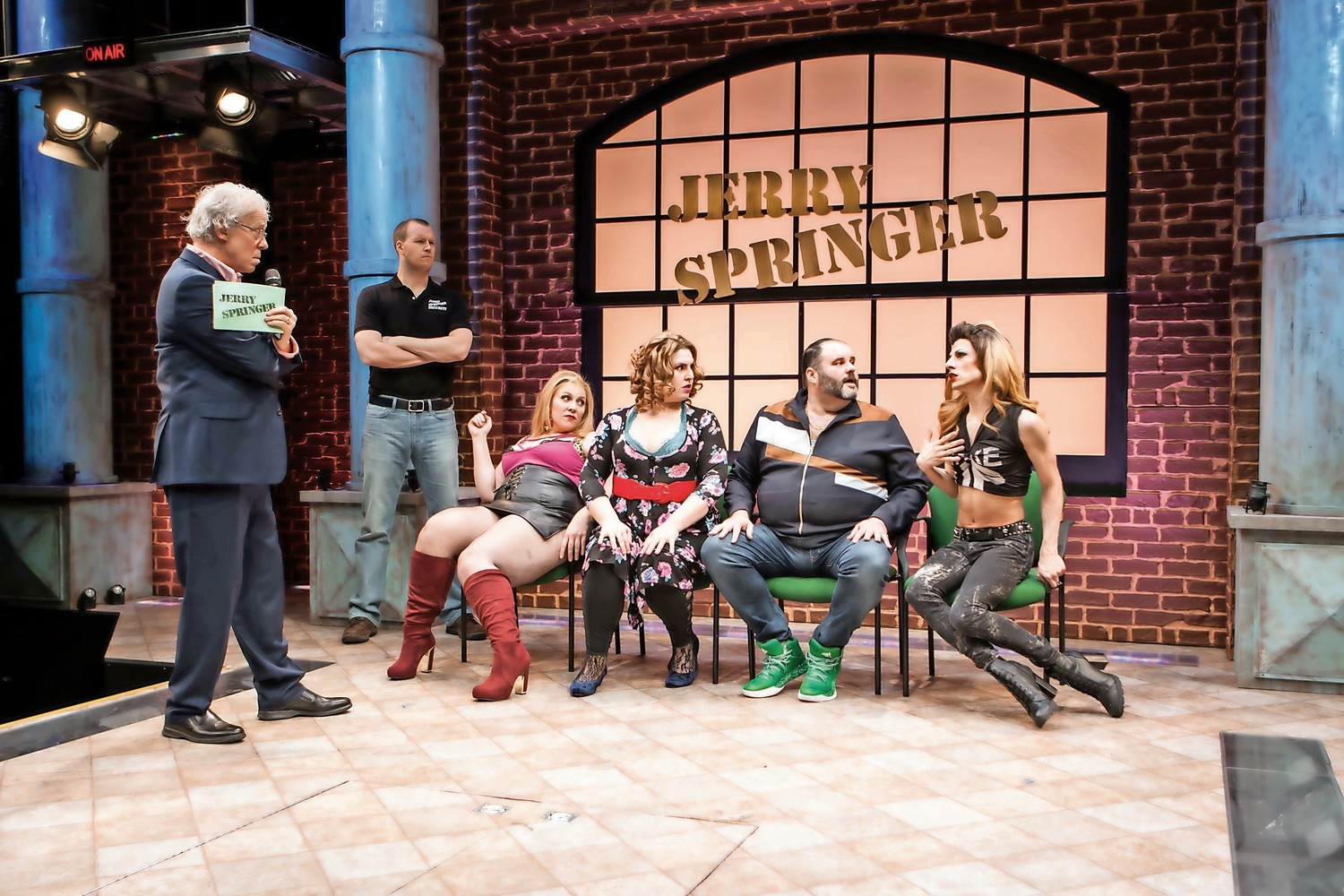 Terrence Mann, left, takes on the persona of shock talk show host in 'Jerry Springer – The Opera,' recreating the kind of craziness found on the television show with actors that include, from left, Billy Hepfinger, Beth Kirkpatrick, Florrie Bagel, Luke Grooms and Sean Patrick Doyle.