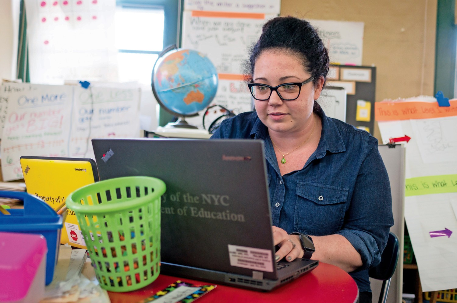 In addition to a smartboard, Elsa Gilheany, a kindergarten teacher at P.S. 24, uses laptops issued by the New York City Dept. of Education as part of her lessons.