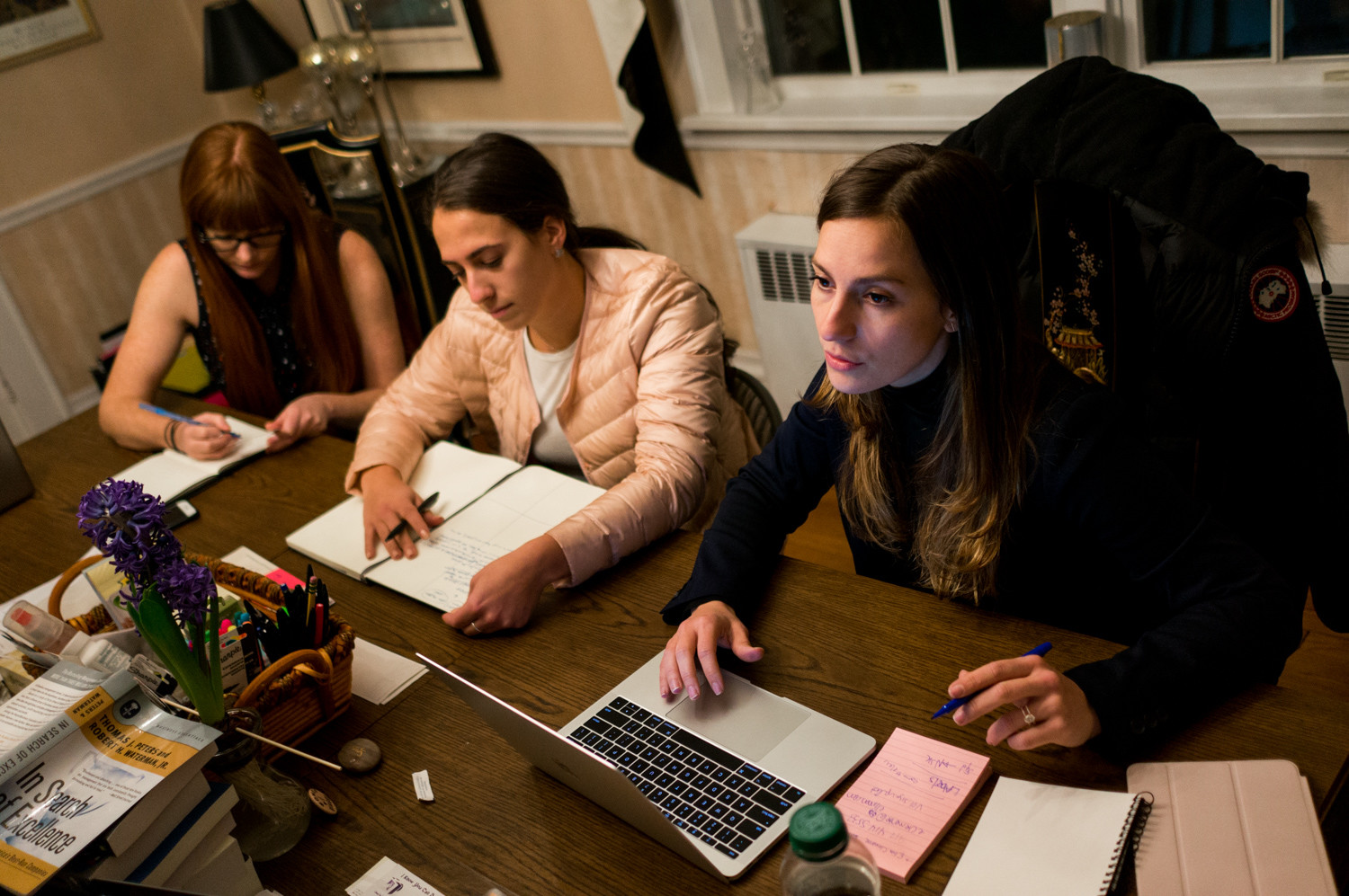 Alessandra Biaggi speaks with her campaign team during a meeting in her dining room. Biaggi left her job as an aide to Gov. Andrew Cuomo to launch her efforts to upset Sen. Jeff Klein in the Democratic primary.