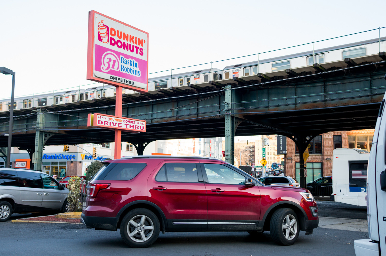 A driver leaves the Dunkin' Donuts parking lot at West 230th Street and Broadway. Parking there and going to other businesses nearby — or to the post office, just steps away — risks getting towed by IPK Automotive Inc. Several people have accused the company's drivers of using intimidating and what some say are illegal tactics like demanding cash payments.
