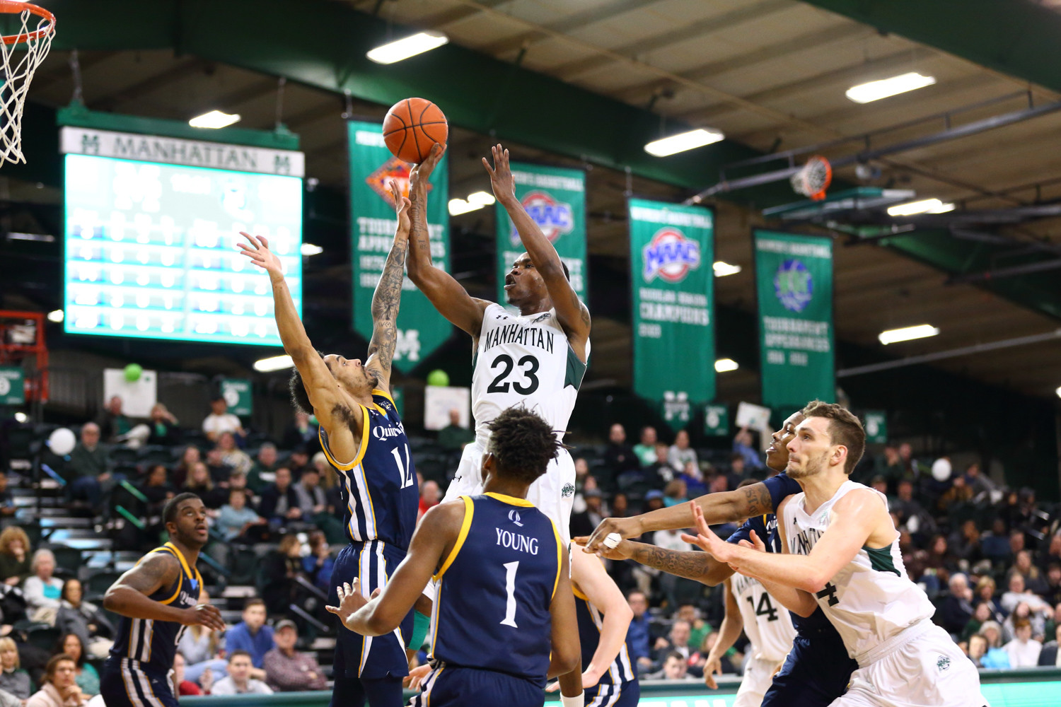 Manhattan senior Rich Williams scored 23 points on Senior Day as Manhattan downed Quinnipiac in double overtime.