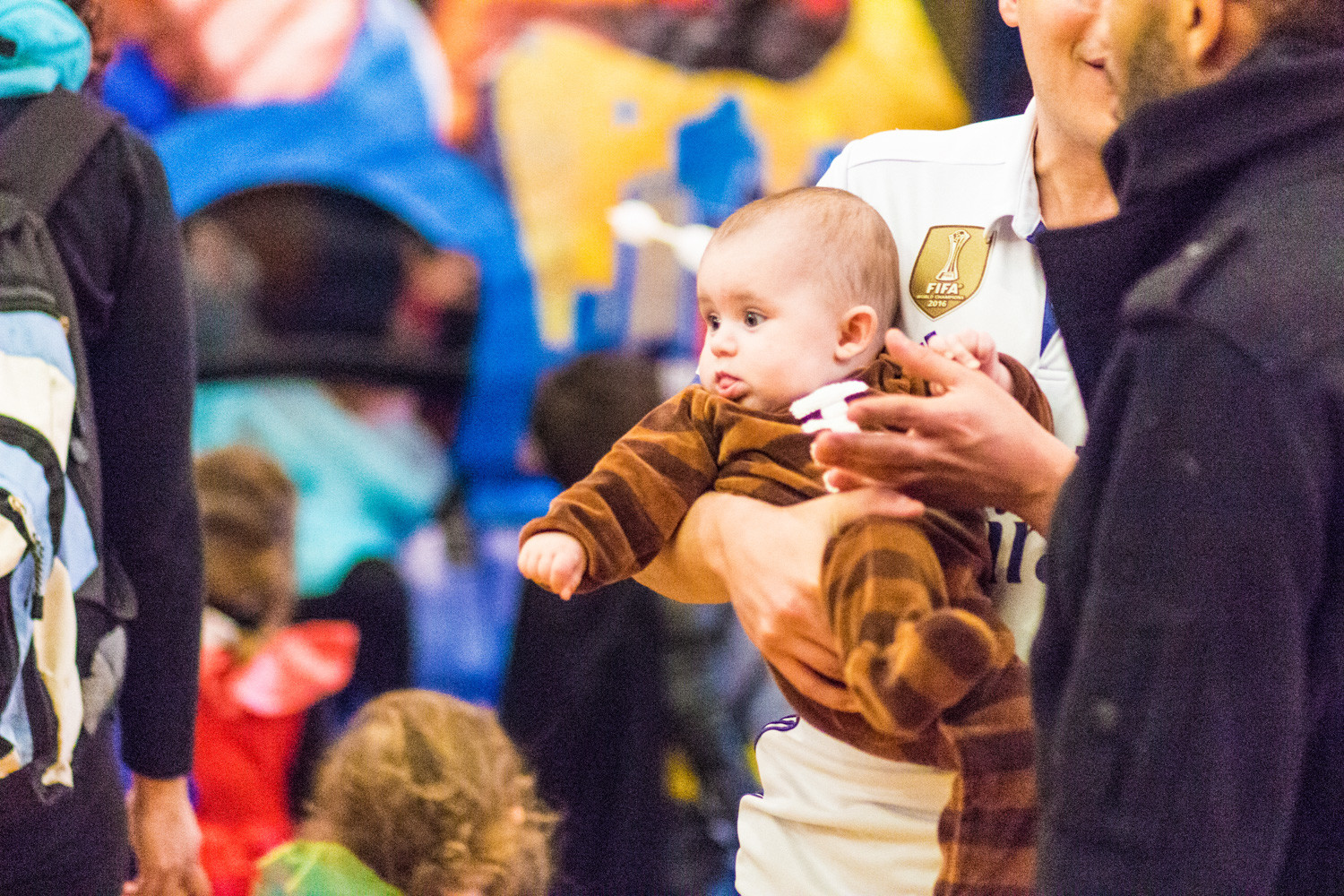 Costumes abounded at the Riverdale Temple's Purim carnival — including a baby dressed as a football.