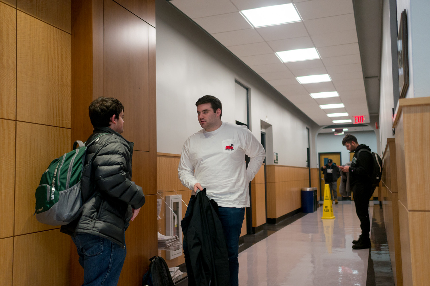 Manhattan College students talk in between classes in De La Salle Hall where many business classes are held. The school of business will be renamed The O'Malley School of Business, thanks to a $25 million donation by Thomas O'Malley.