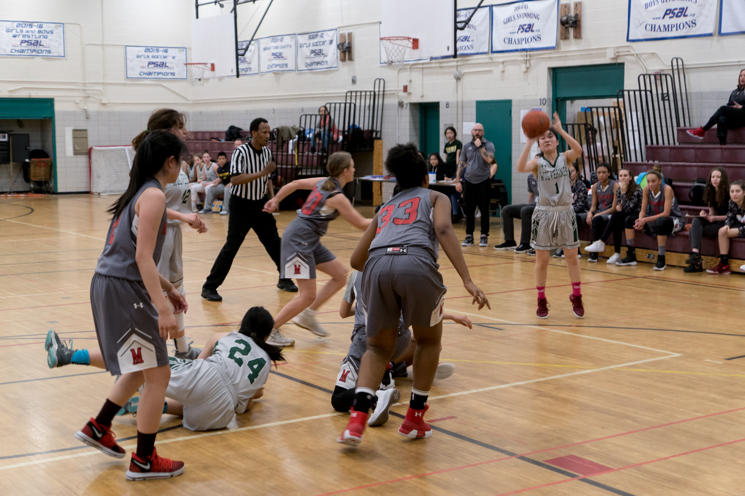 Senior guard Michelle Kim, who led Bronx Science with a game-high 15 points, gets ready to launch a three-pointer in the Wolverines' PSAL playoff victory over Millennium.