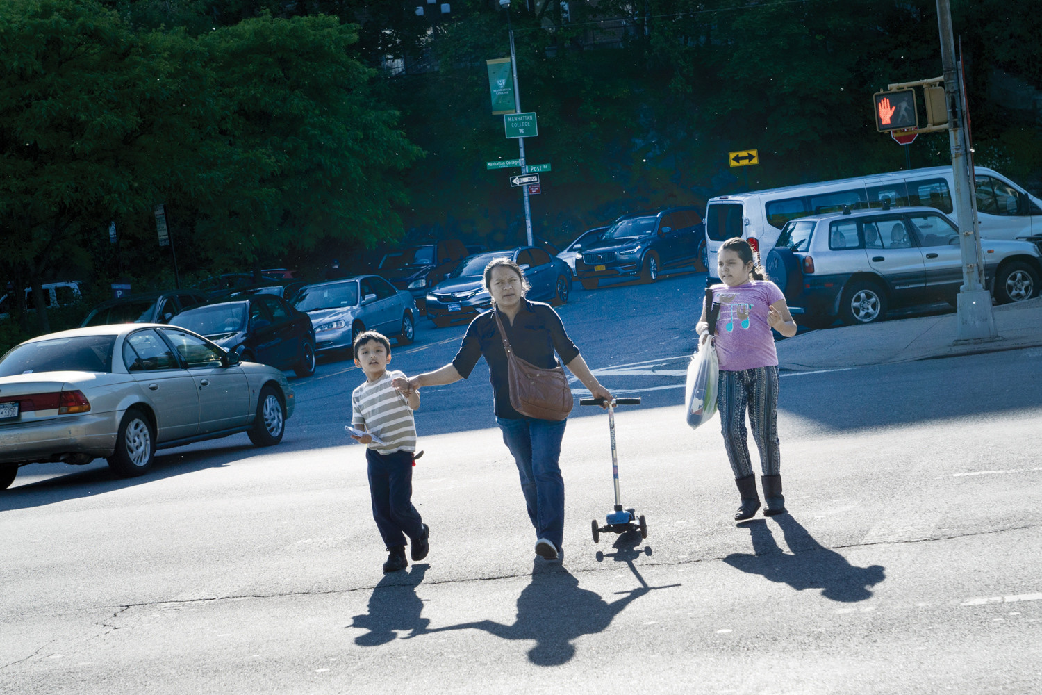 Pedestrians walk across Broadway towards Van Cortlandt Park last year.