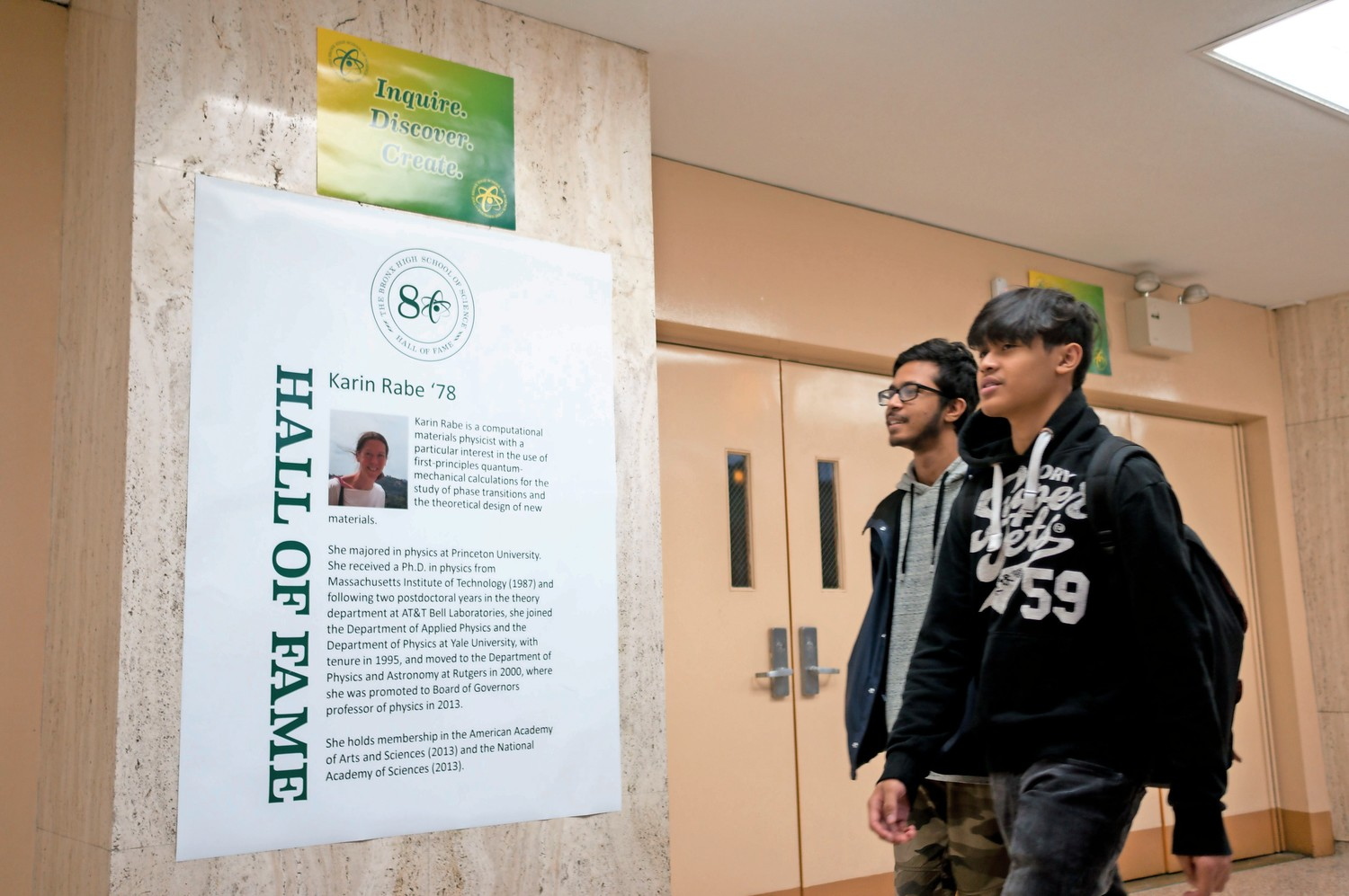 Students at the Bronx High School of Science walk past a hall of fame poster celebrating 1978 alumna Karin Rabe. Bronx Science recently unveiled a hall of fame to celebrate the school's notable alumni.