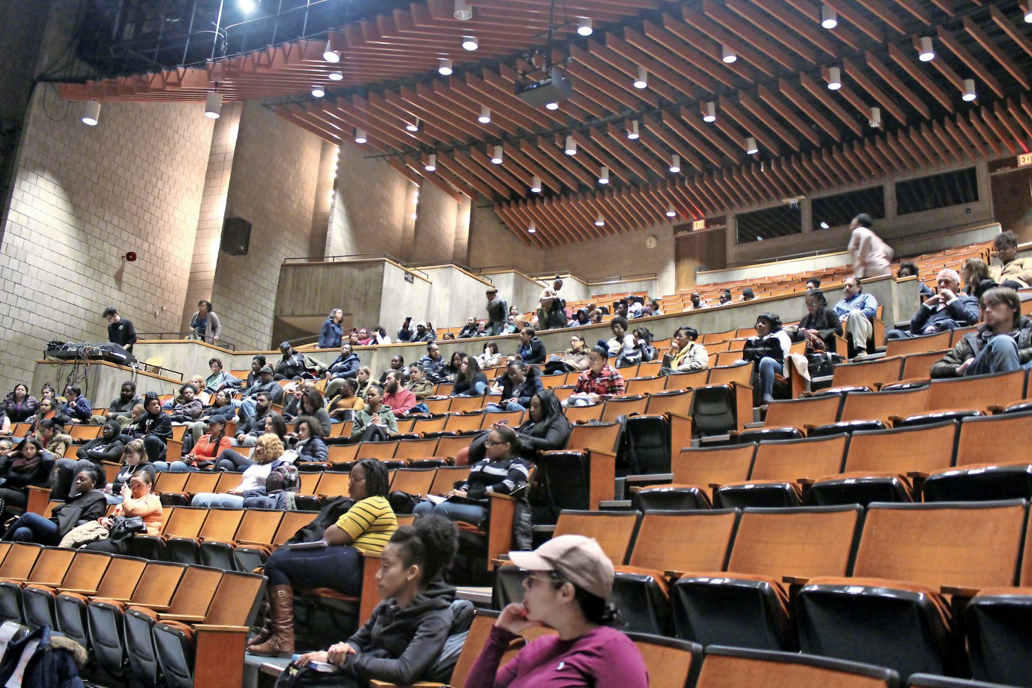 Students and faculty attend a panel discussion on mass incarceration at Lehman College. Damian Stapleton, a former inmate at Rikers Island, was one of the guest speakers.
