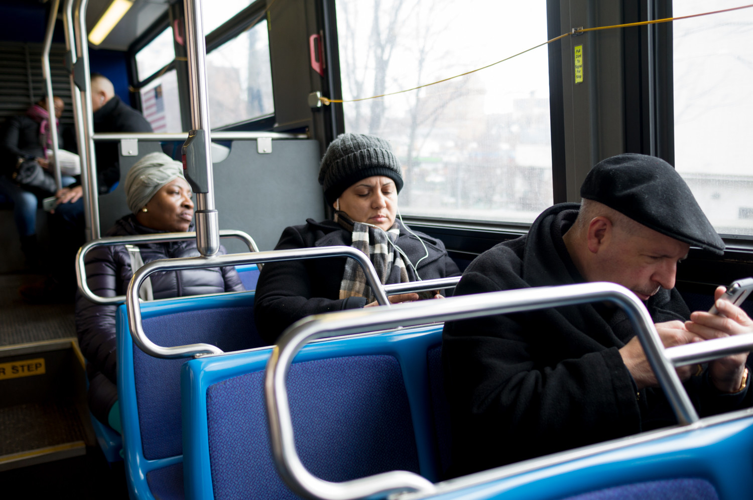 Elizabeth Bermudez, far left, finds a way to make mass transit fares work, but more than 300,000 working poor New Yorkers struggle to make those costs each day. A program offering half-priced fares could help an estimated 800,000 people living at or below federal poverty guidelines.