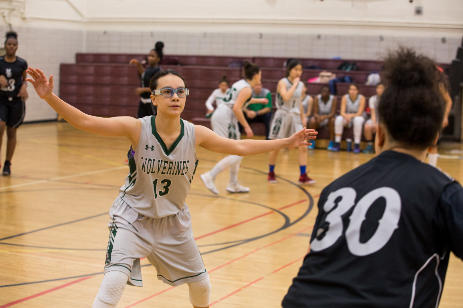 Sarang West, shown here in an earlier game this season, went down with a dislocated thumb in Bronx Science's playoff game with Brooklyn Community, a departure the Wolverines could not overcome in their 65-53 loss.