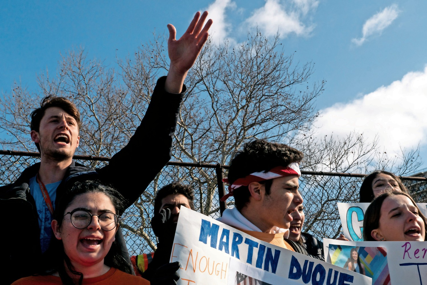 Students from Bronx Science shout 'Never again' at a protest against gun violence at Harris Field.