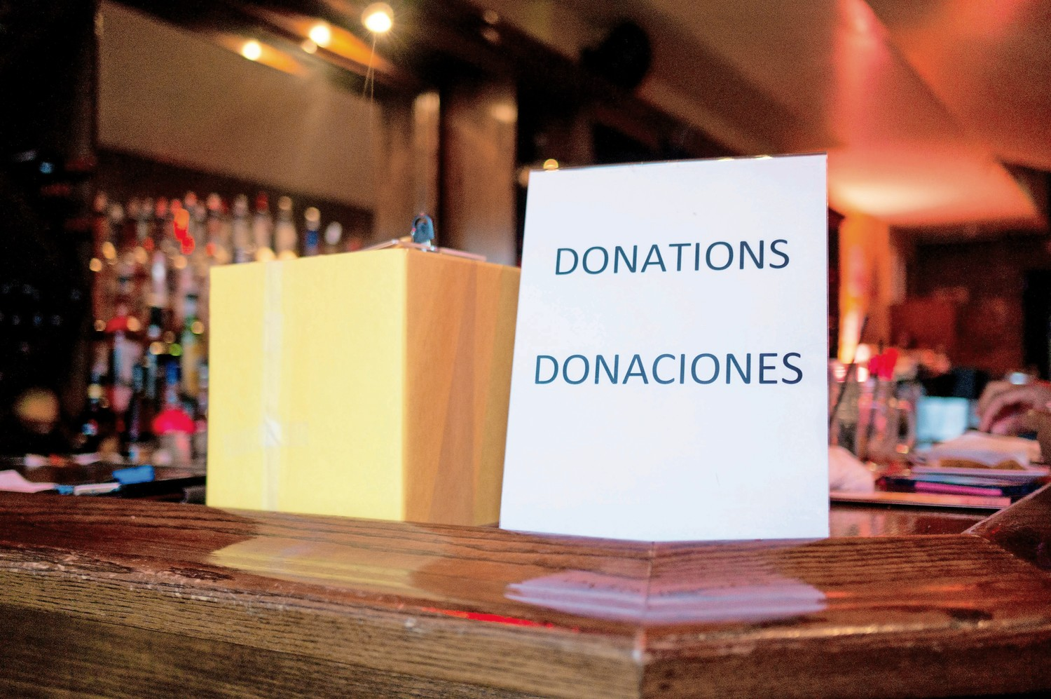 A box for donations sits on the bar at Amor Cubano, a Cuban restaurant in Harlem. Lehman College professor Teresita Levy held a fundraiser at Amor Cubano for a weeklong trip she and her students are planning to take to Cuba.