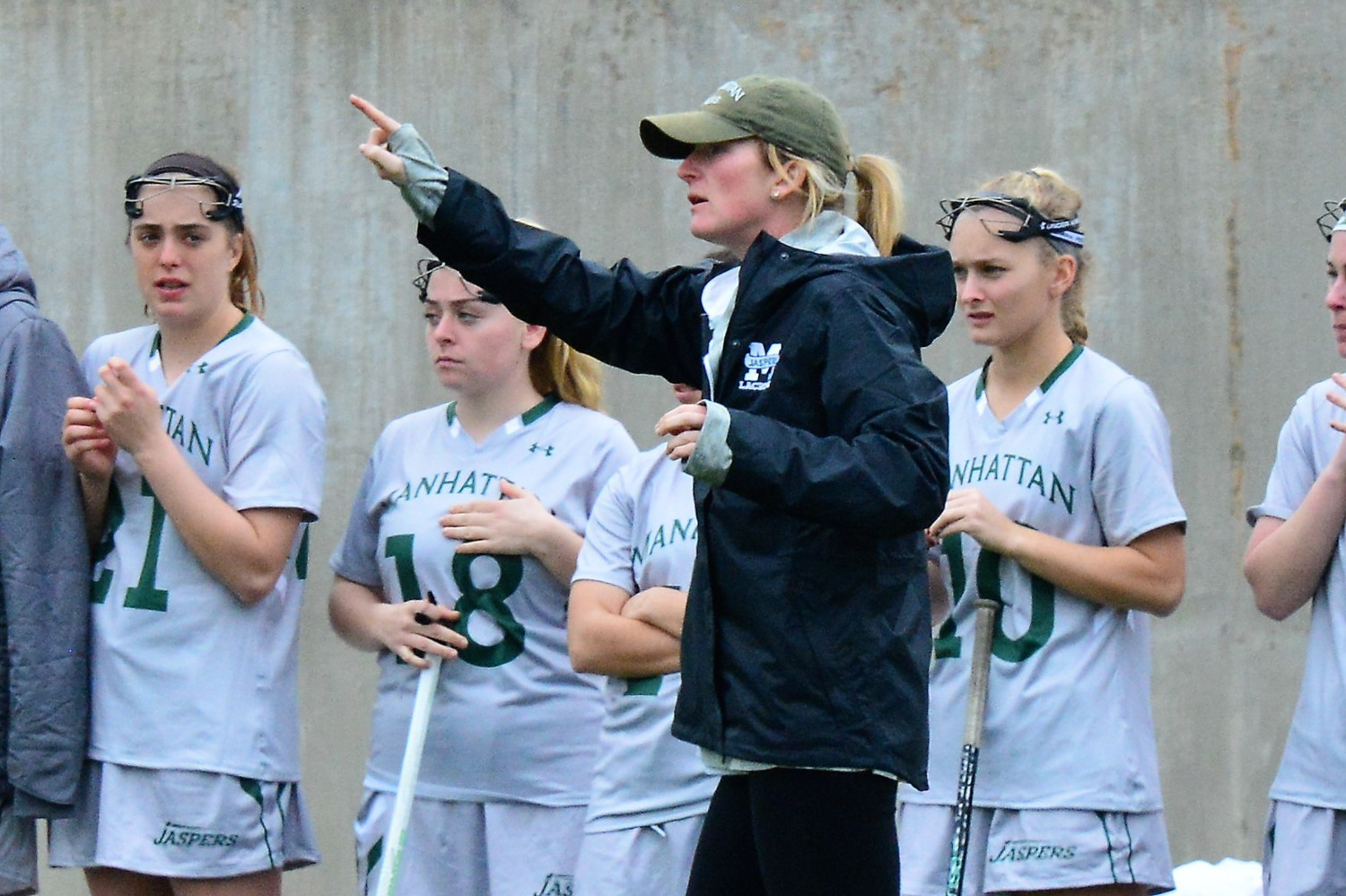 Manhattan head women's lacrosse coach Katie McConnell directs her team in a recent game. The second-year coach thinks her Jaspers could be headed for a turnaround this season.