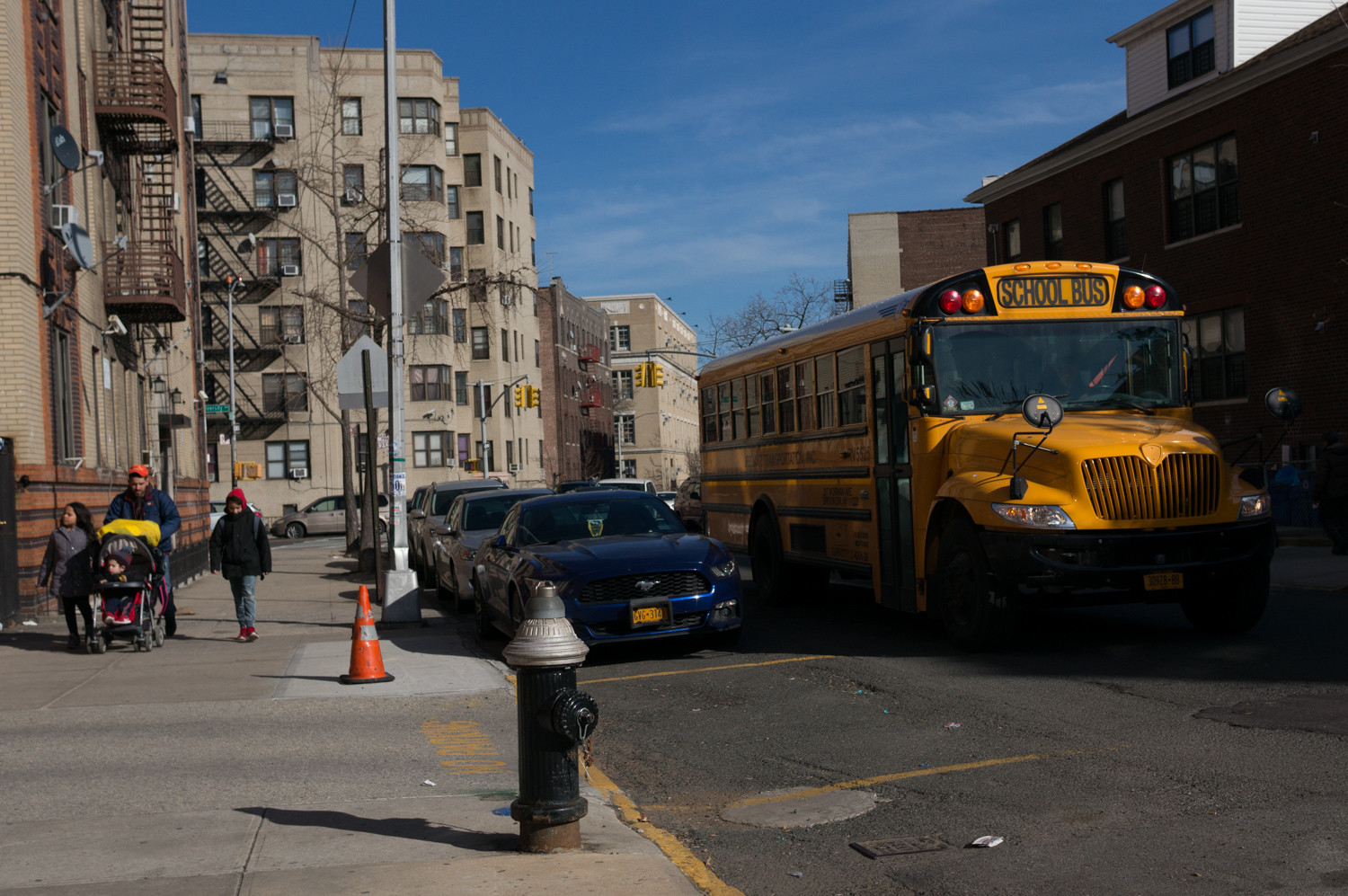 A school bus works its way along West 197th Street in Kingsbridge Heights. Community Board 8 is pushing to have the area downzones as a way to hamper real estate developers from build high-density residential complexes.
