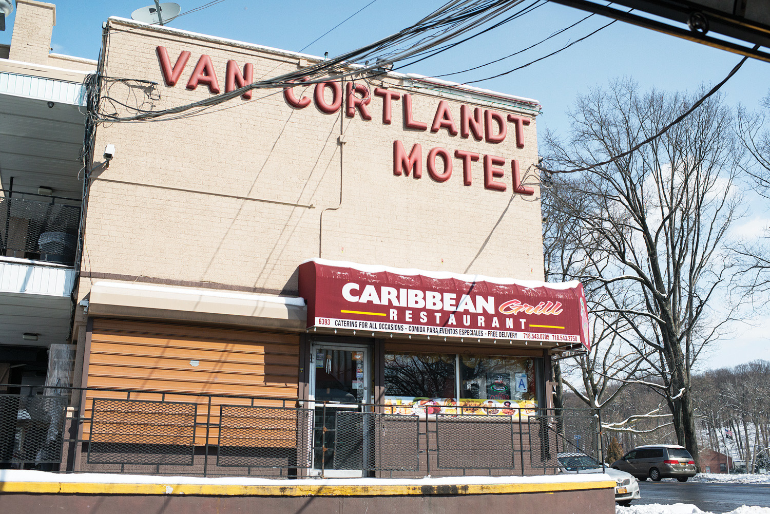 Police are searching for three women and two hooded, armed bandits who reportedly brandished a firearm and made off with $96,000 they took from a man staying at the Van Cortlandt Motel in North Riverdale.