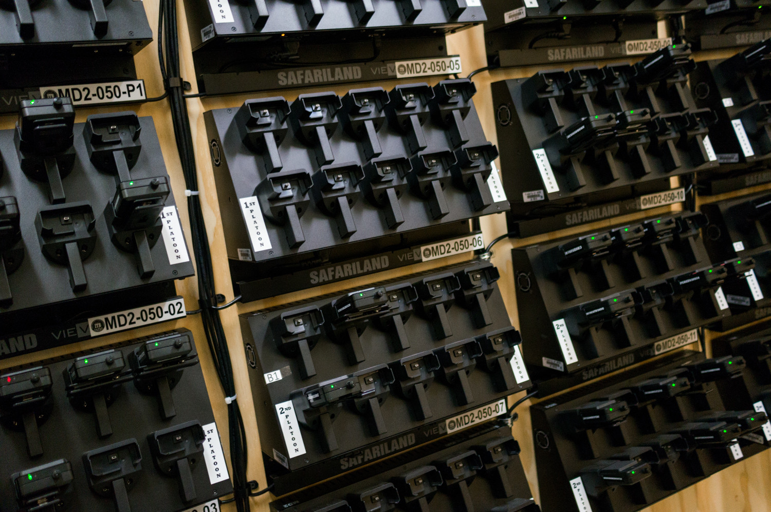 A wall of docks in the 50th Precinct serves both to recharge and upload data from body cameras worn by patrol officers. The Civilian Complaint Review Board, an independent police oversight agency, relies on video evidence as an important tool in its investigations.