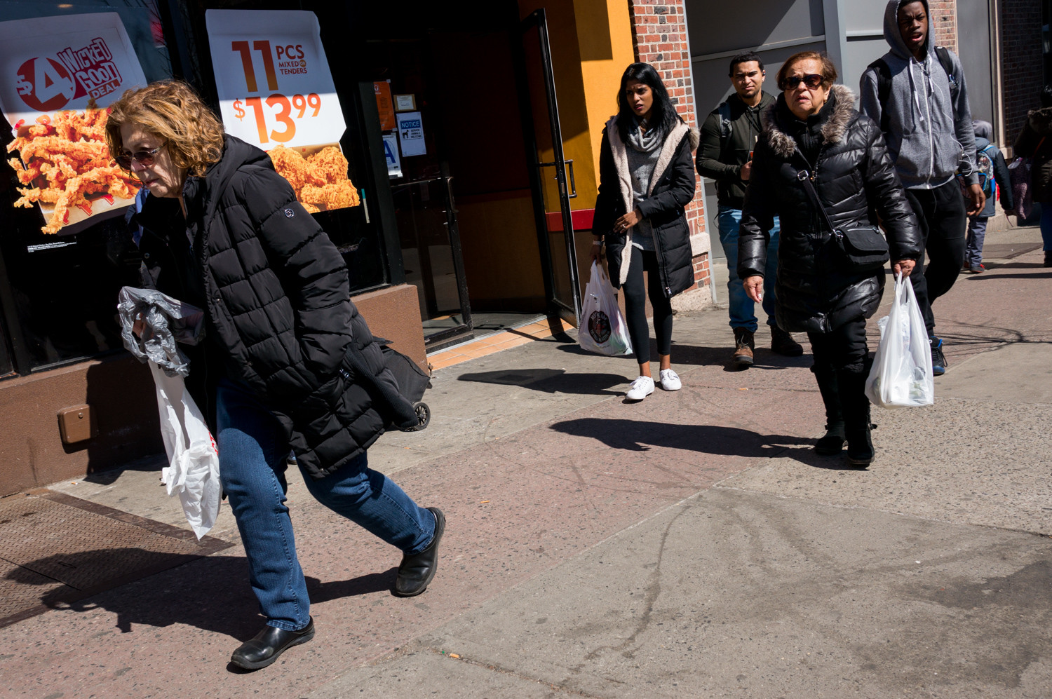 While pedestrians in front of the Popeyes restaurant at West 231st Street in Kingsbridge carry plastic bags from various stores, hundreds of organizations are calling on Gov. Andrew Cuomo to address what they're calling a 'plastic bag crisis,' urging him to ban the thin plastic bags commonly found at supermarkets and bodegas.