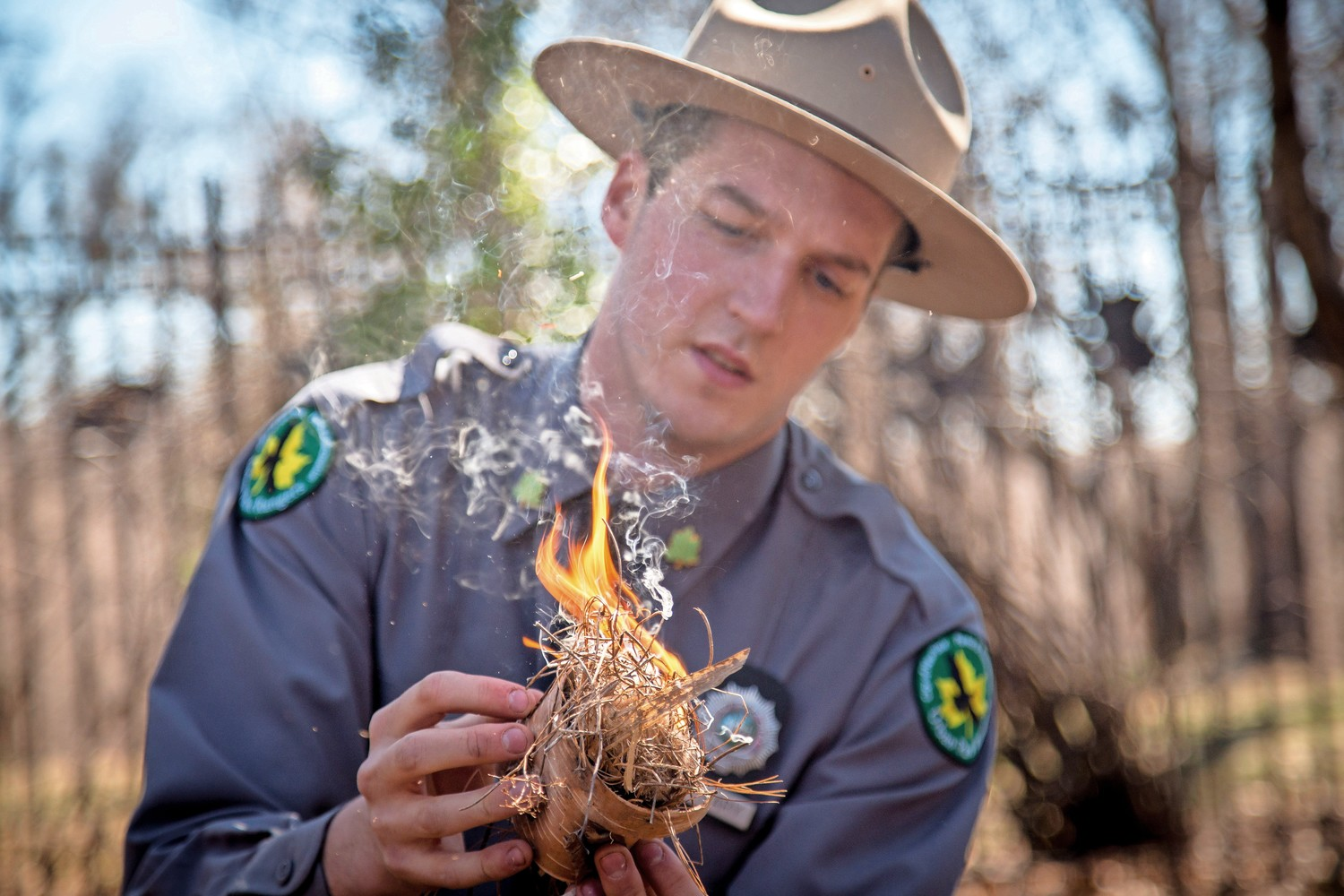 Ian Cleary, an urban park ranger, demonstrates how to use tinder, cattail, white birch, and phragmites to start a fire in the ?Survival Series? workshop in Van Cortlandt Park.
