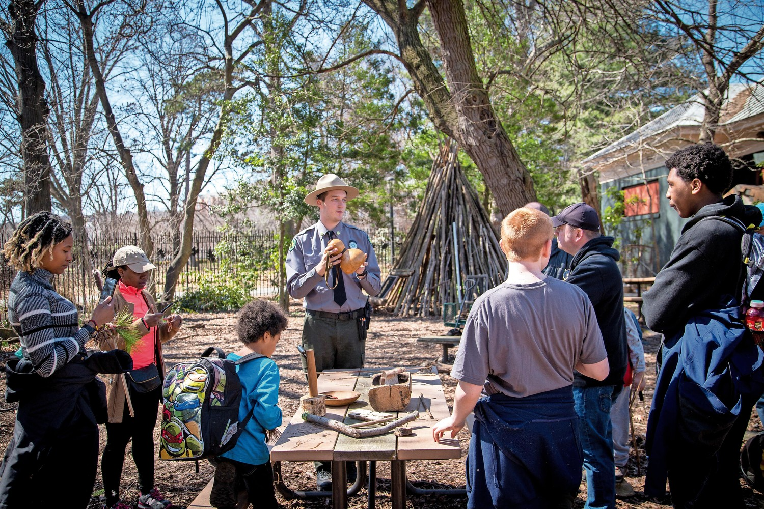 Ian Cleary, an urban park ranger, shows various tools to use in nature in the ?Survival Series? workshop in Van Cortlandt Park.