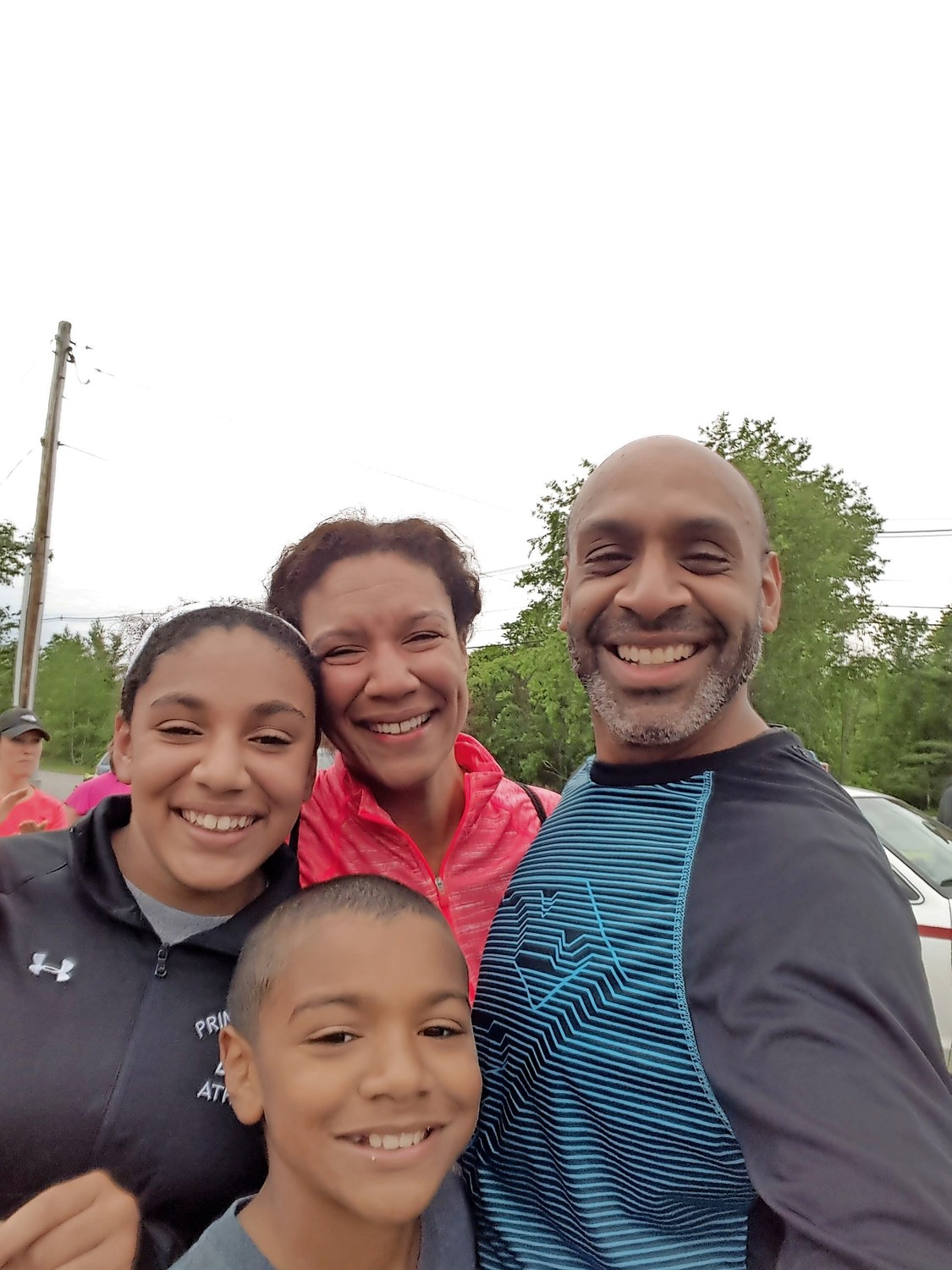 Nigel Furlonge partakes in a 5K race with his family. Furlonge will start as the new principal of Fieldston Upper School in the fall.