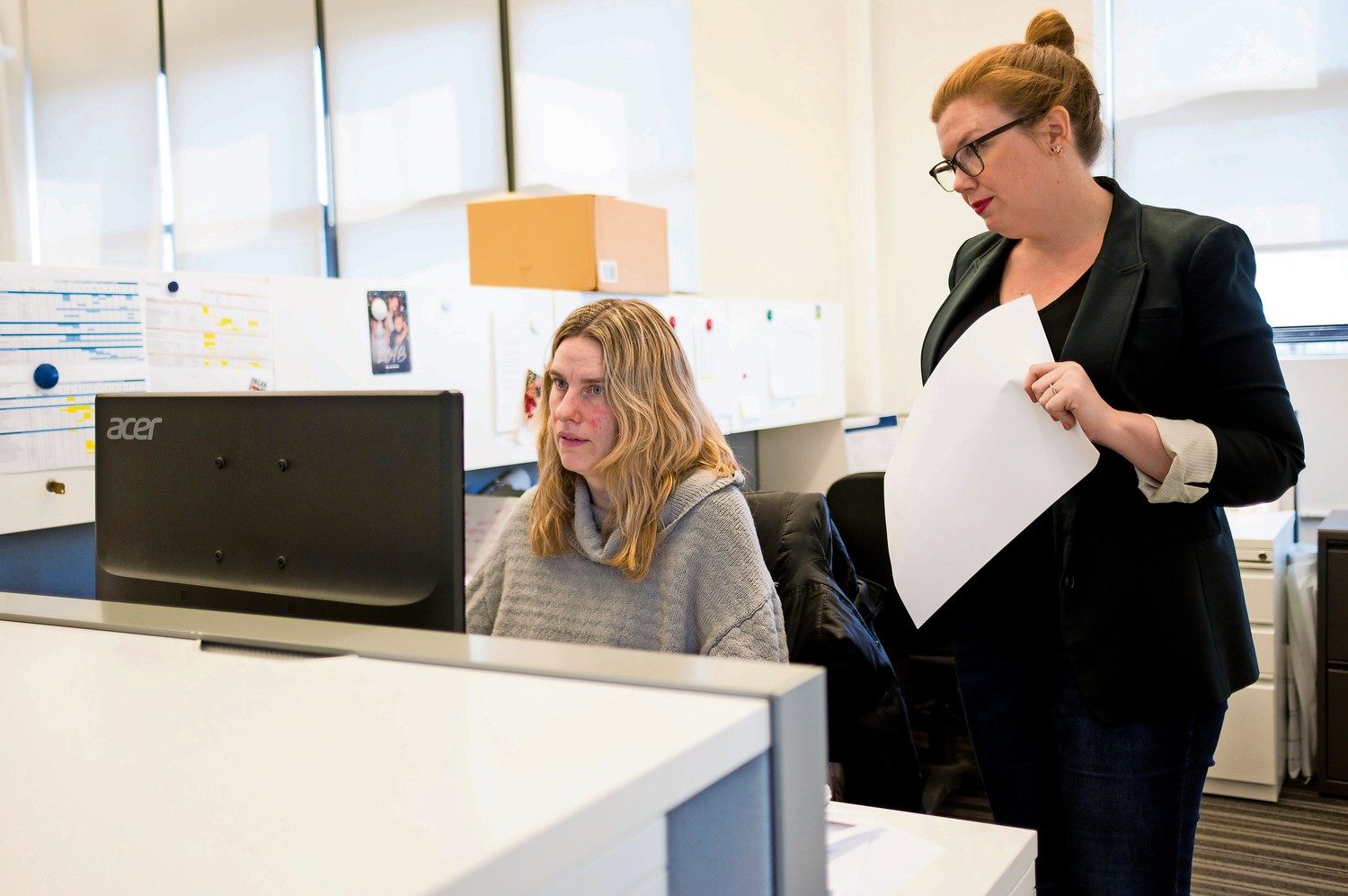 Kristin Ruiz, left, and Ali McSherry discussing marketing materials at LiveOnNY, a nonprofit organization dedicated to facilitating organ donations. The minimum age required to be an organ donor was recently lowered from 18 to 16.