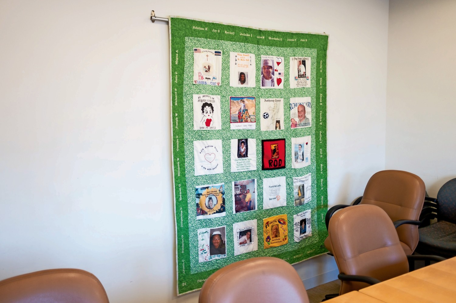 Quilts featuring the stories of organ donors hang through the office space of LiveOnNY, a nonprofit dedicated to facilitating organ donations. The minimum age required to be an organ donor was recently lowered from 18 to 16.