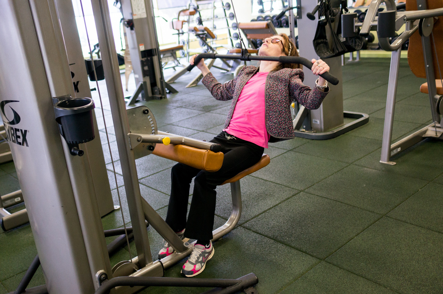 'This is my mom's favorite,' said Judy Fettman, an Ashkenazi Jewish woman, of the lat pull-down machine. Fettman has familial dysautonomia, a genetic disorder more prevalent in the Ashkenazi community than in the general population. She calls North Riverdale's Skyview-on-the-Hudson co-op home, where she lives in an apartment a couple floors down from her parents.