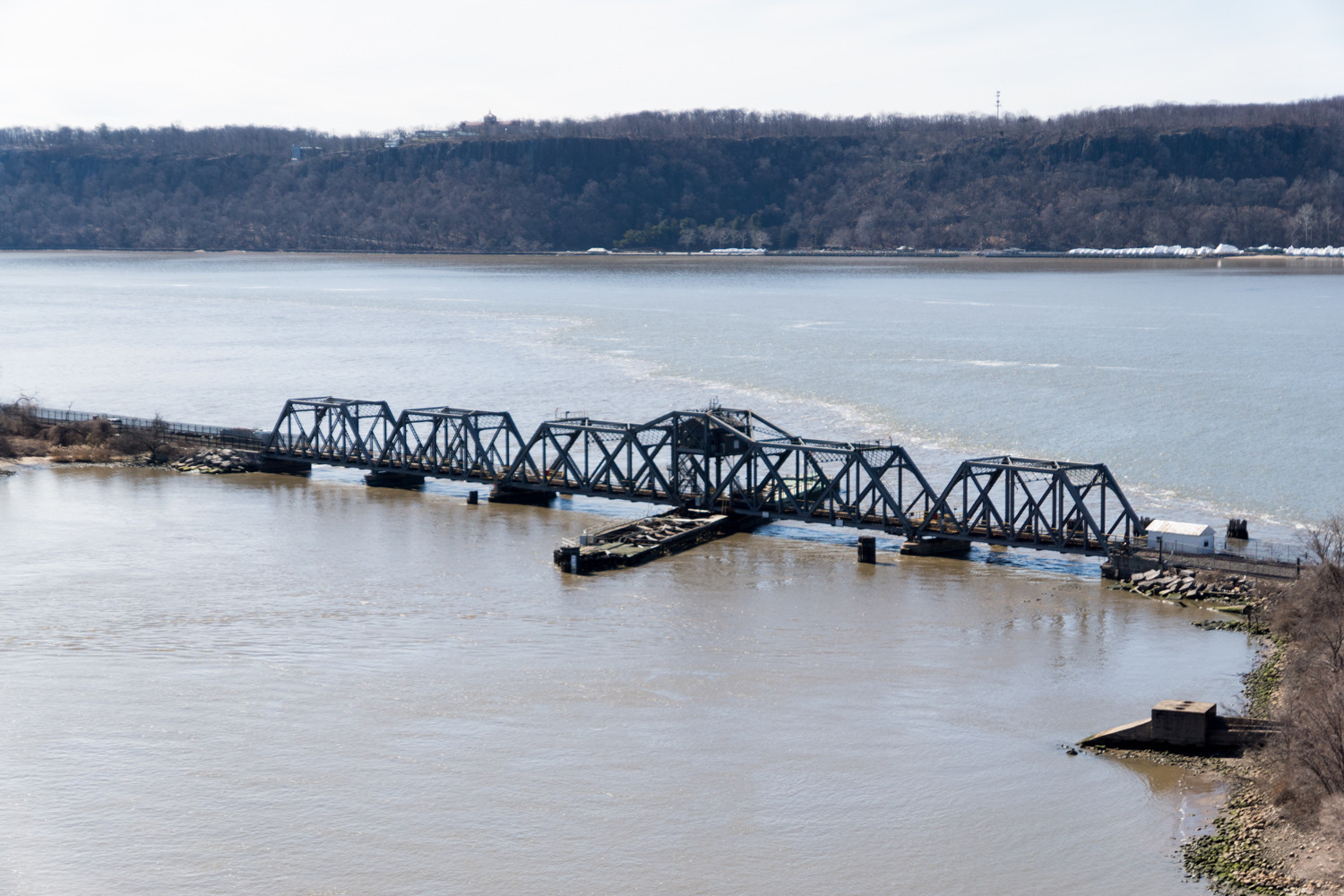 The Spuyten Duyvil Bridge suffered damage to its base from Hurricane Sandy in 2012. Amtrak trains passing through Spuyten Duyvil will take a different route this summer, with diversions planned to Grand Central Terminal, as Amtrak works on rehabilitating its infrastructure, including repairing the bridge.