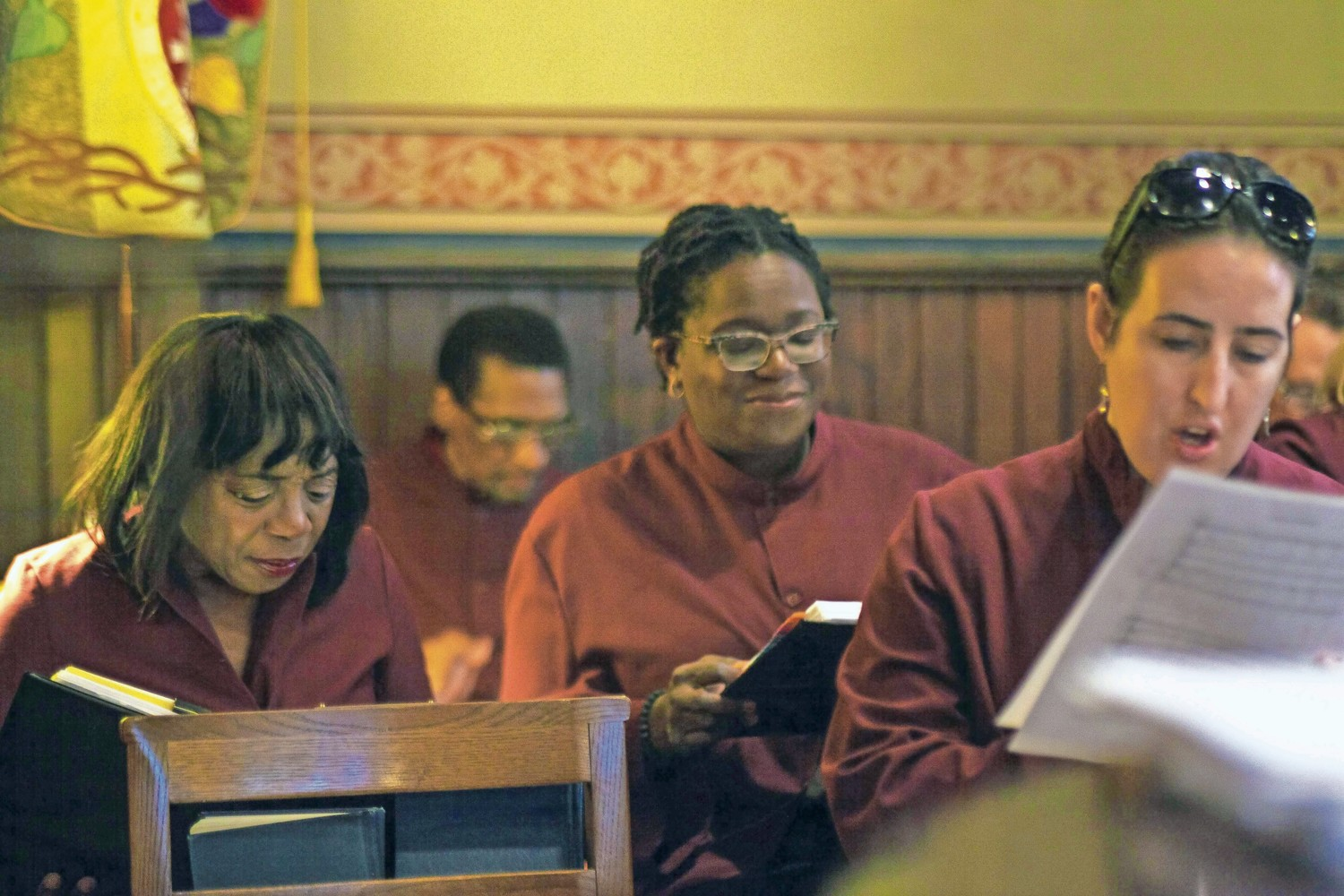 Renee Minus White, left, looks over sheet music during a rehearsal with the Christ Church Riverdale Choir.